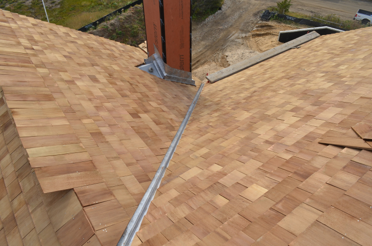 Roof shingles and flashing on Sunset Green Home