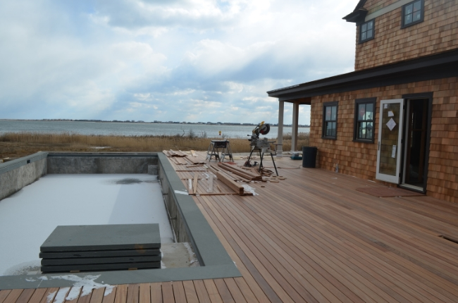 FSC certified cumaru decking alongside Sunset Green Home's pool