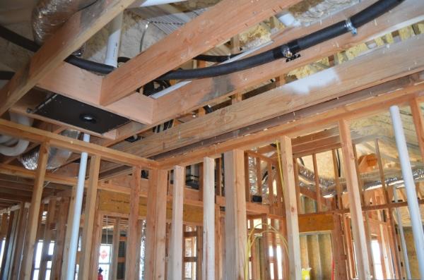 Sprinkler heads in flat ceiling