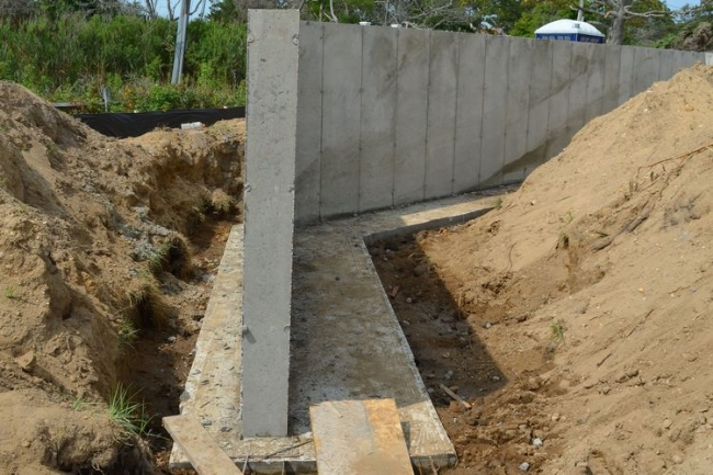 Sunset Green Home's retaining wall and footings during construction.