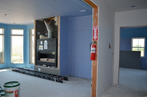 SilentFX in the ceilings and wall between the living room and adjacent bedroom.  AirRenew on the remaining living room walls.  Type X fire resistant gypsum on walls that will be paneled.