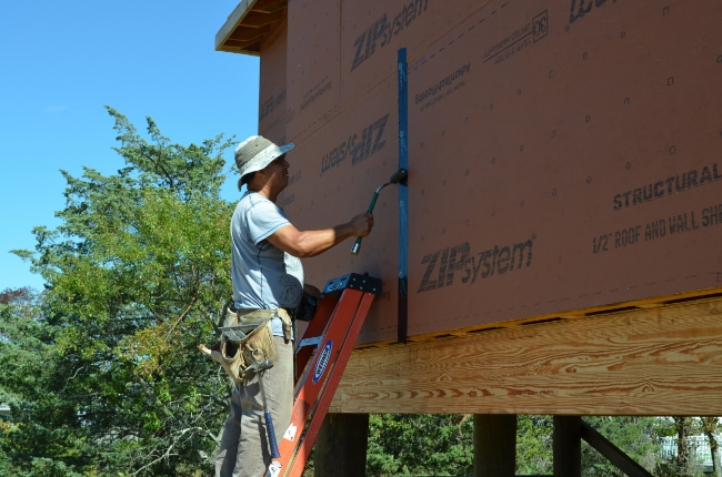 ZIP System sheathing comprising regionally grown, harvested and manufactured wood content