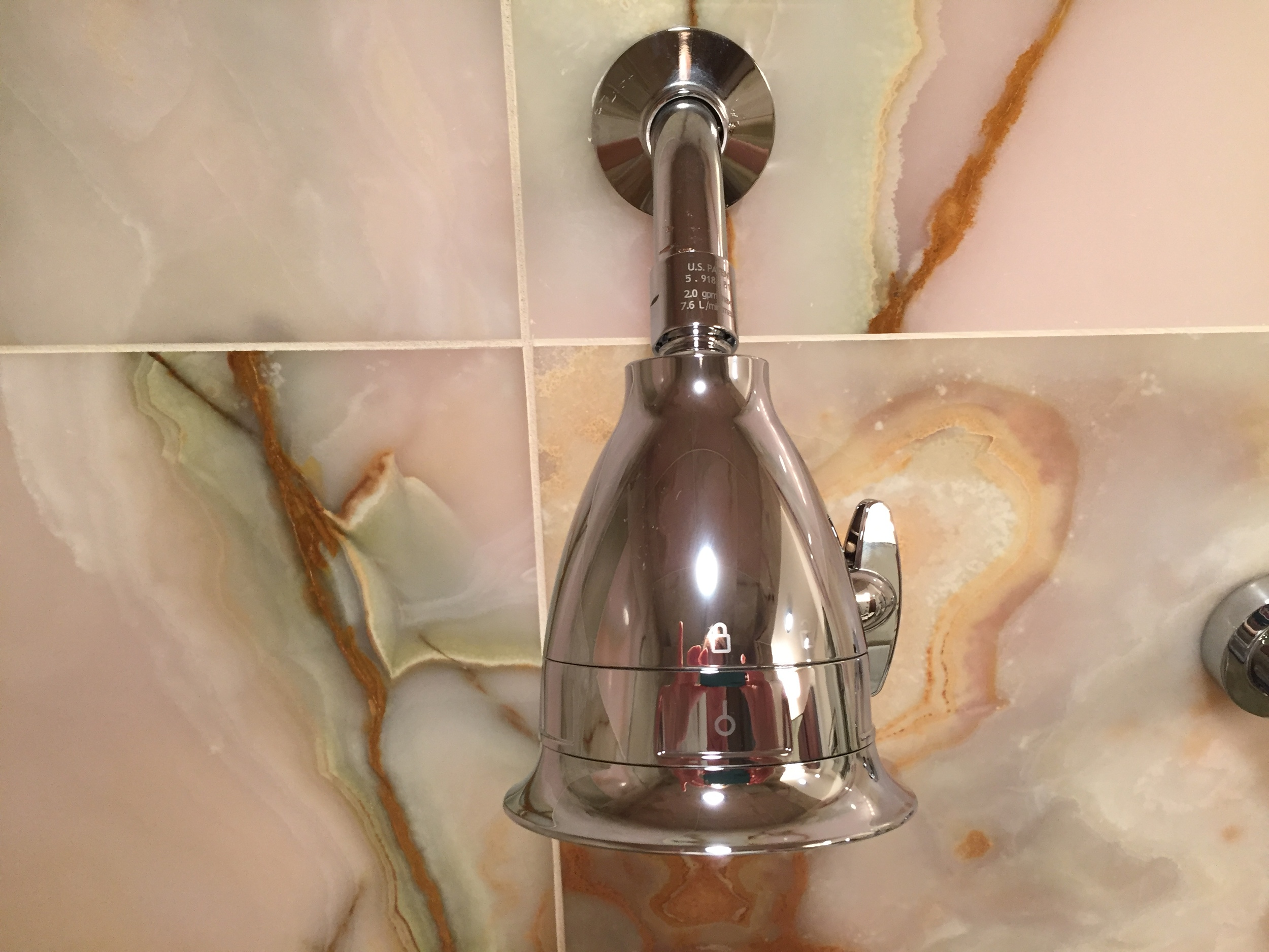 Install the new shower head by twisting clockwise