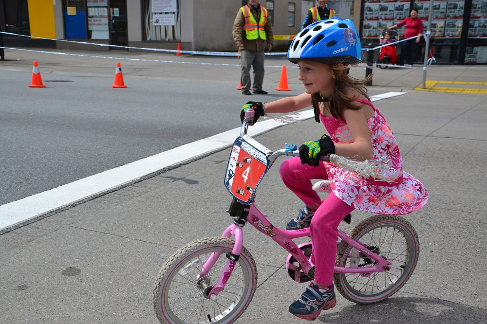 Campbell Coles-Lyster of Maple Ridge participates in the free kid's race in her hometown's downtown core on Sunday. Photo: Pete Whalen