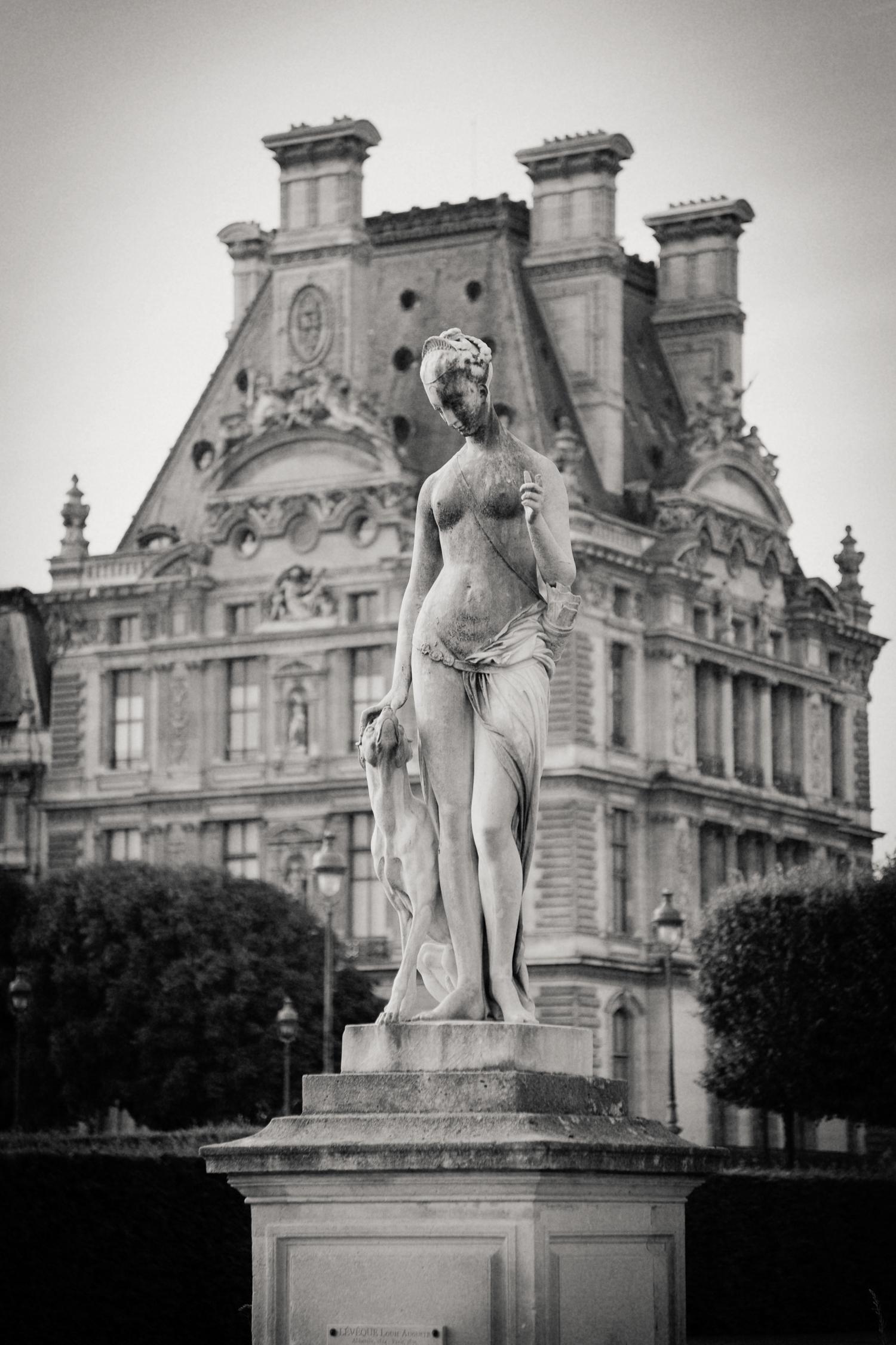 statue outside Louvre, Paris 2014.
