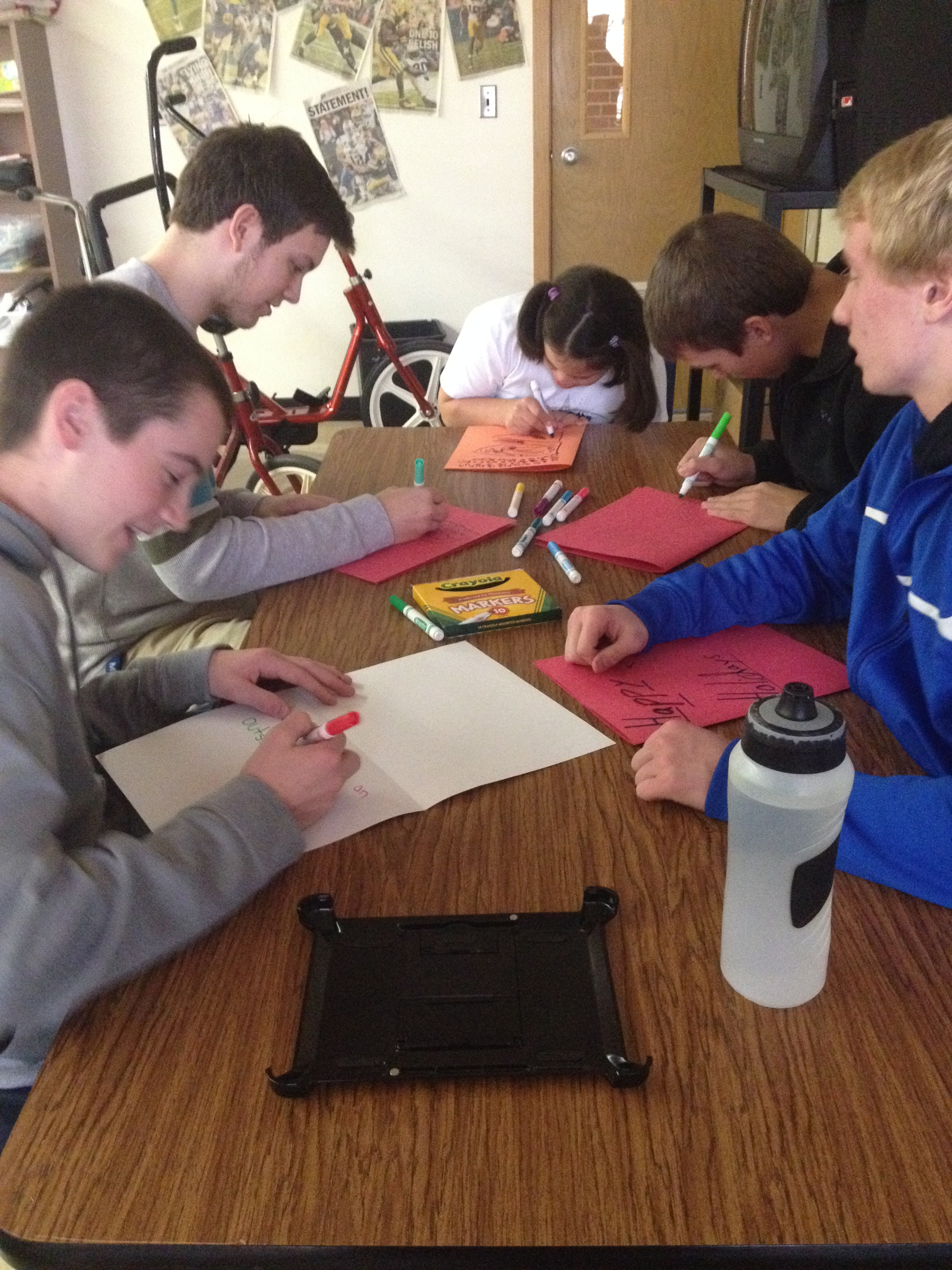 Members of We Are One club collaborate with Special Education students to make cards for VA hospital.
