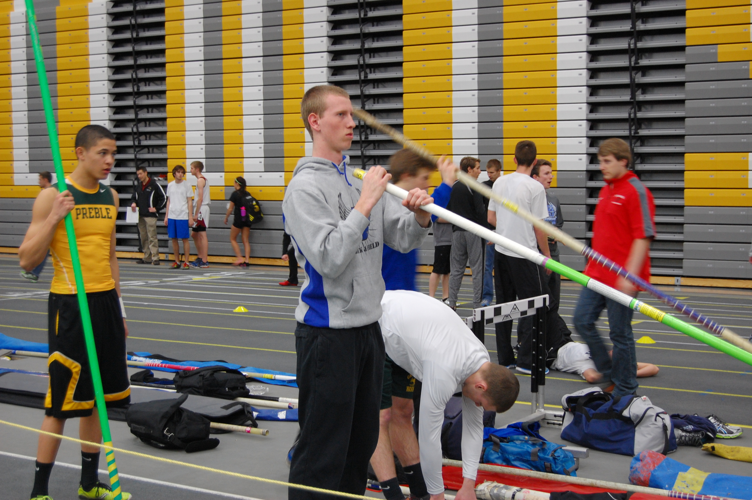 Junior Joe Vils warms up for the pole vault.