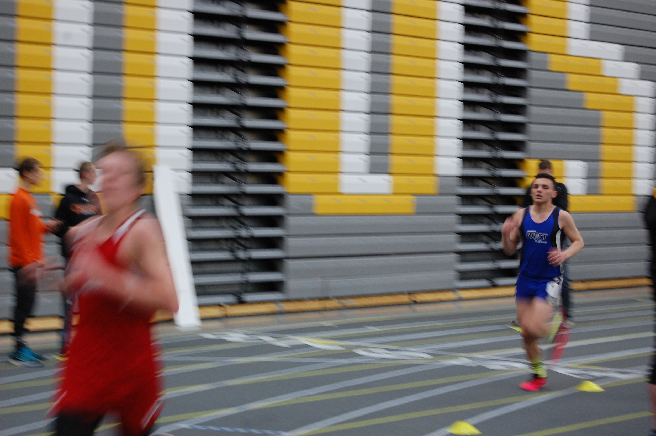 Junior Bryce Remy makes his final lap of the two mile race.