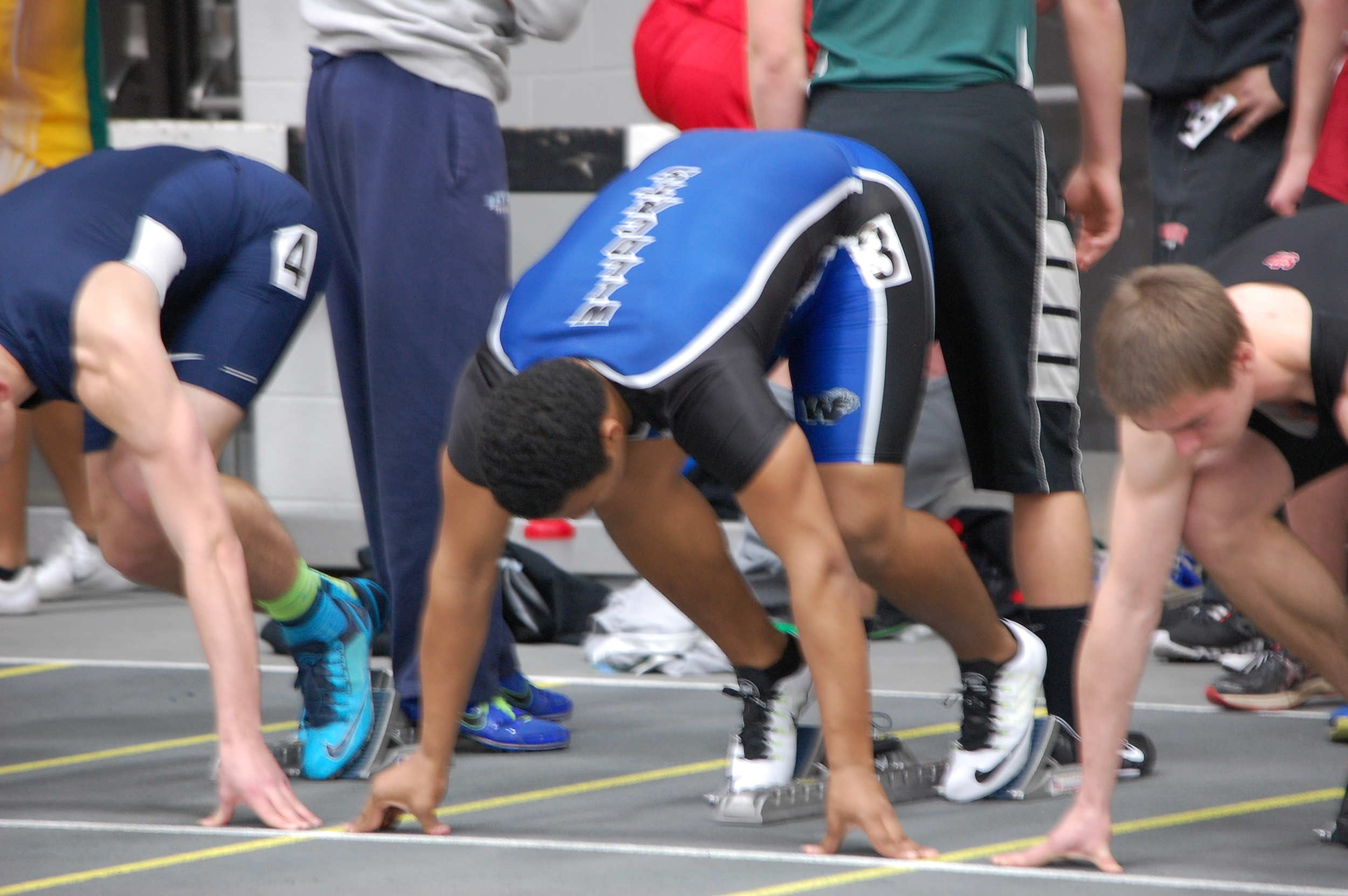 Junior Deshawn Dickinson gets into the ready position for the 60 meter hurdle trials.