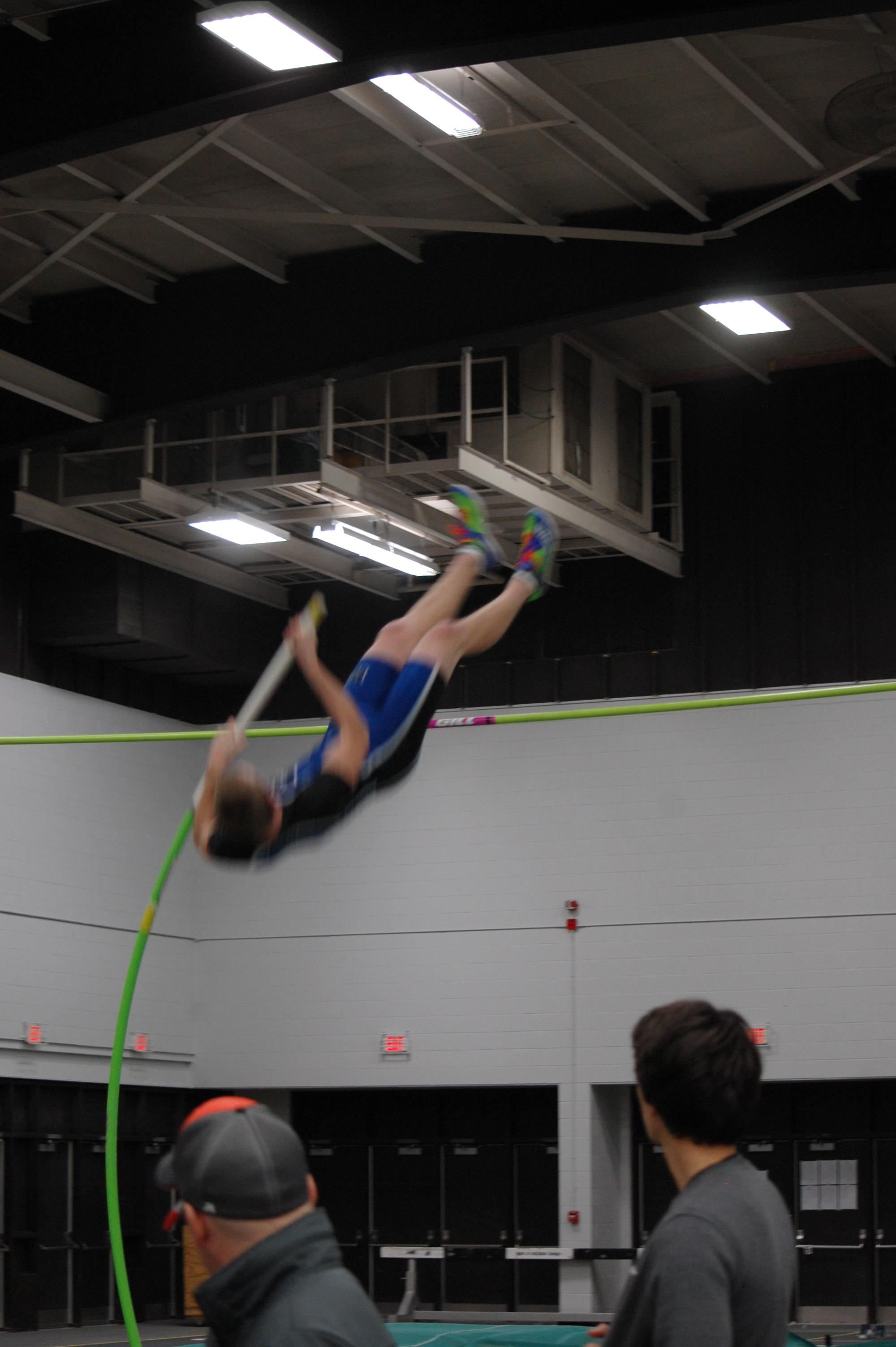 Joe Vils executes perfect pole vault form.