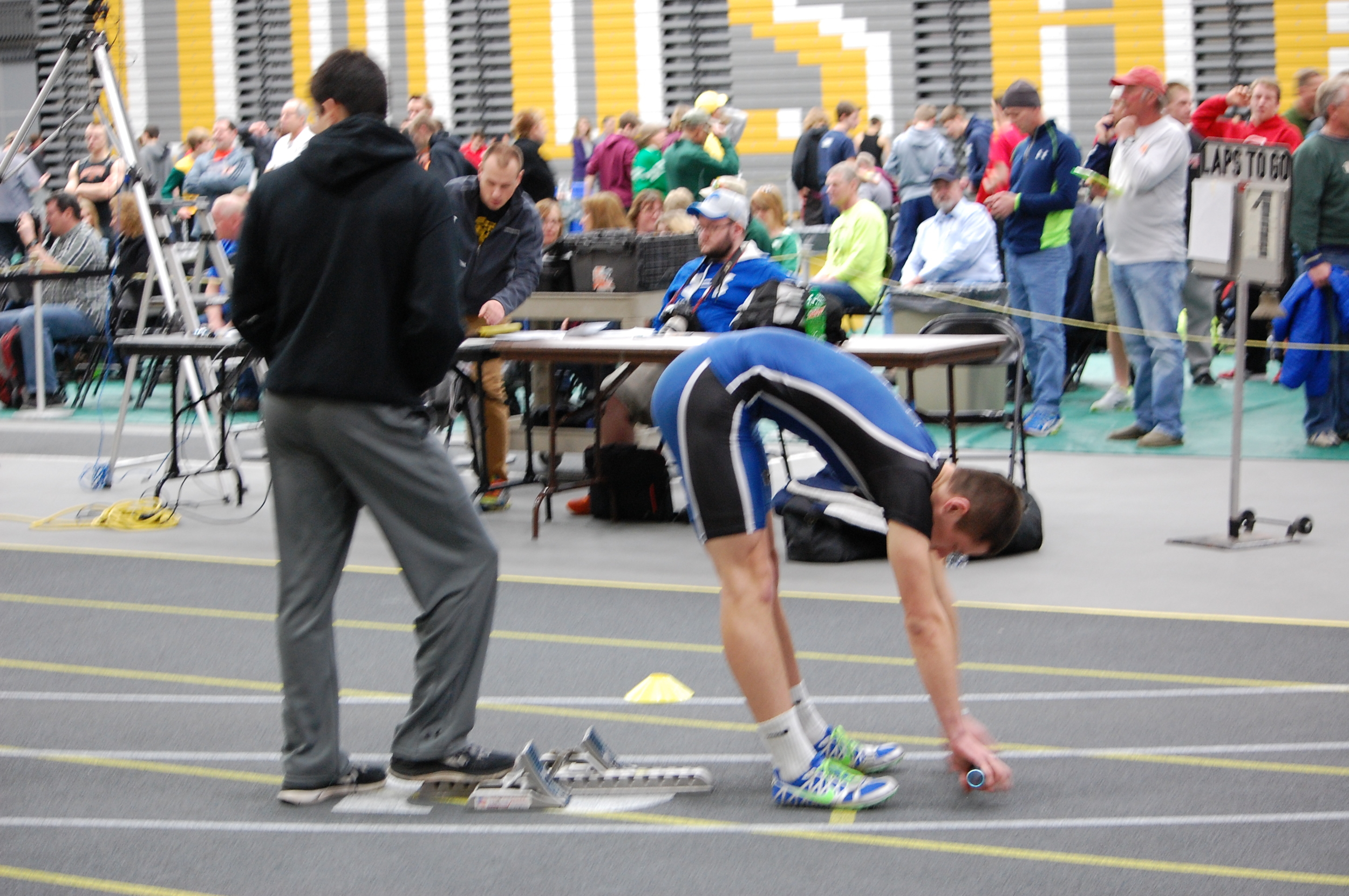 Isaiah Merrill stretches before getting ready for the 800 meter relay.