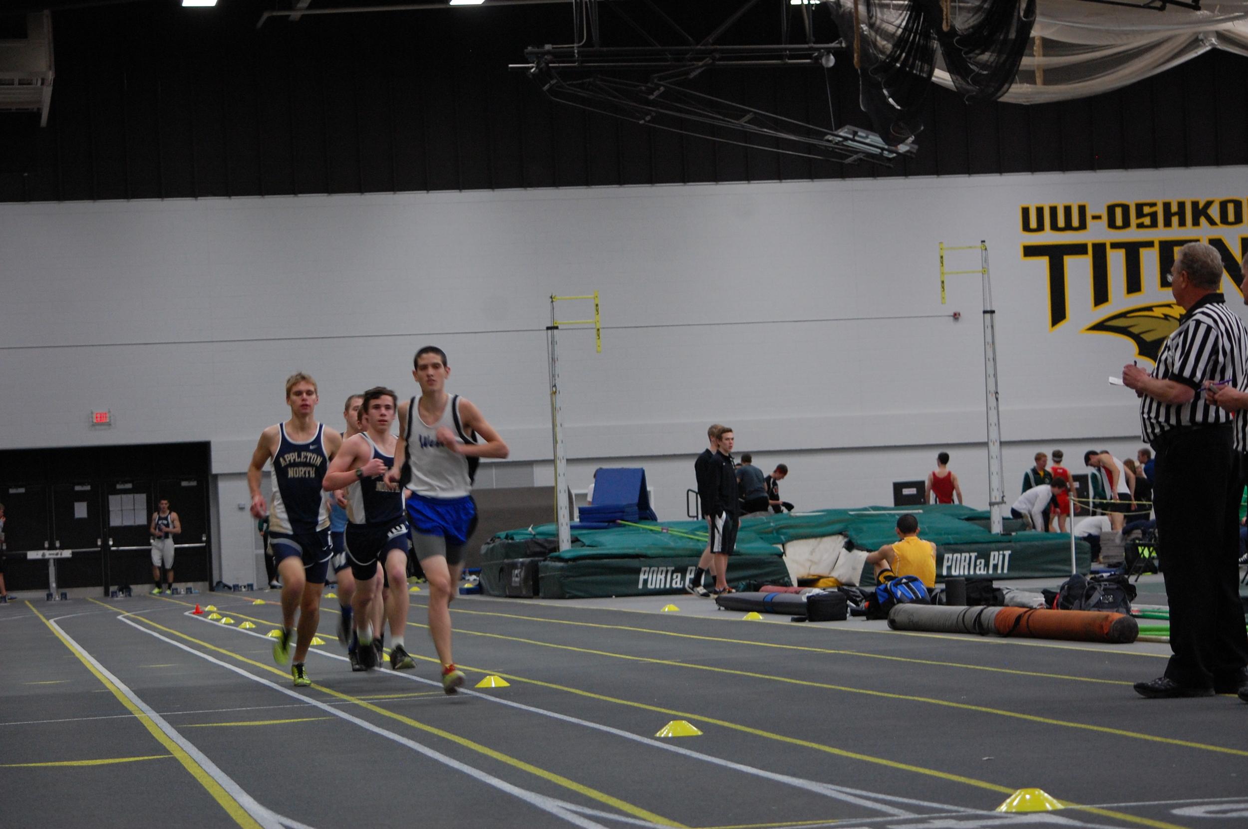 Freshman Will Scheuermann leads in the two mile race.