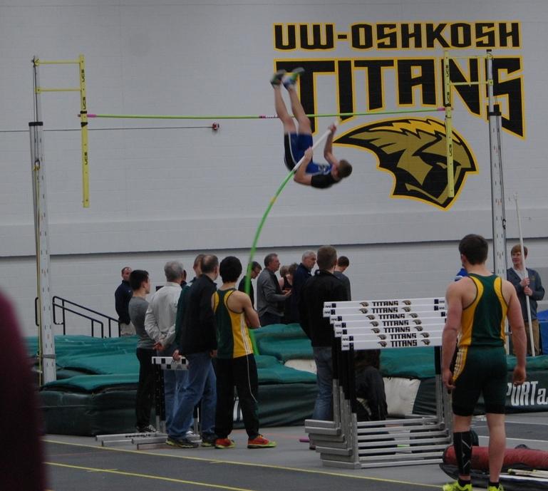 Joe Vilperforms another leap over the pole vault bar.