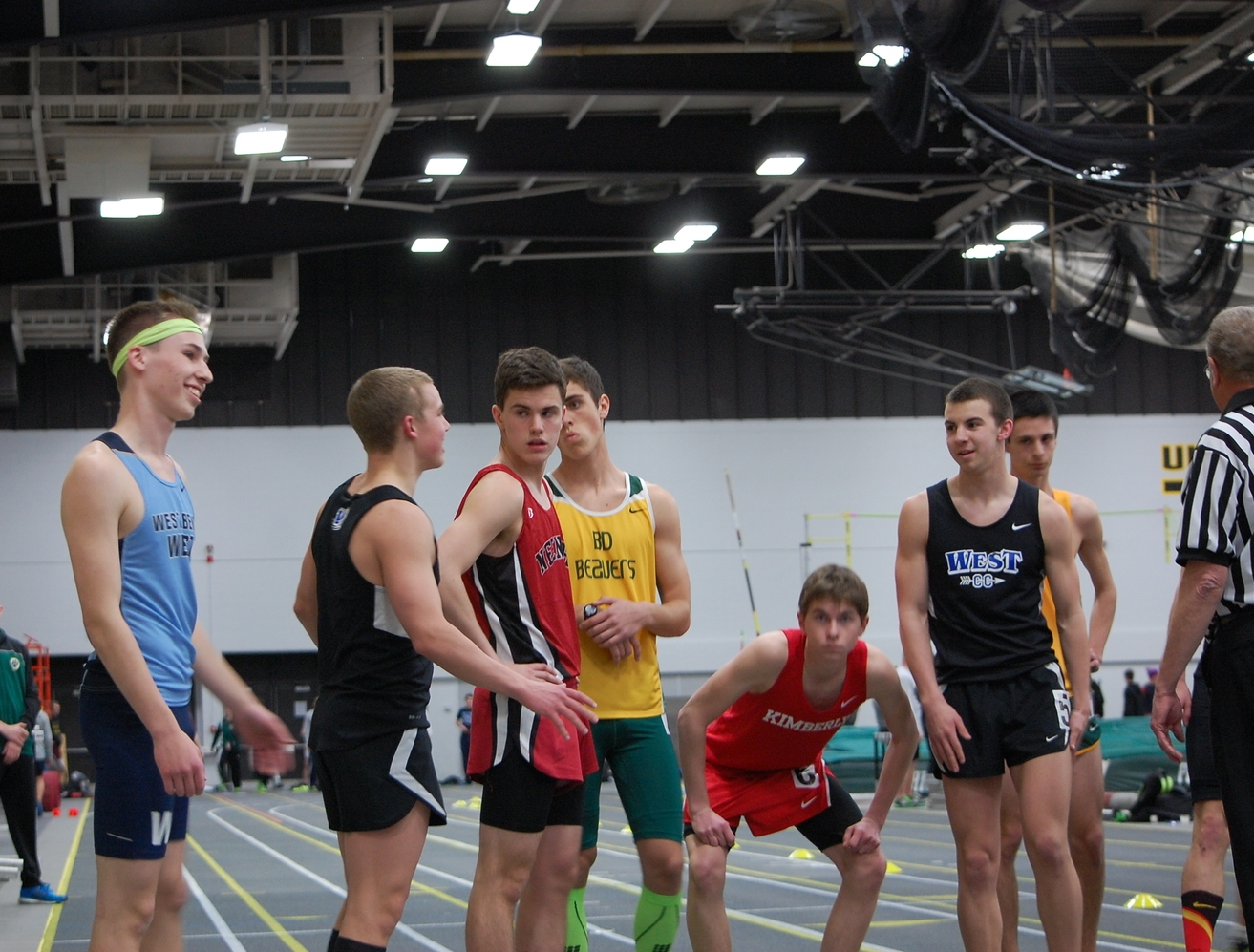 Seniors Rourke Lenz (left) and Jake Rost (right) talk out strategy before their mile race.