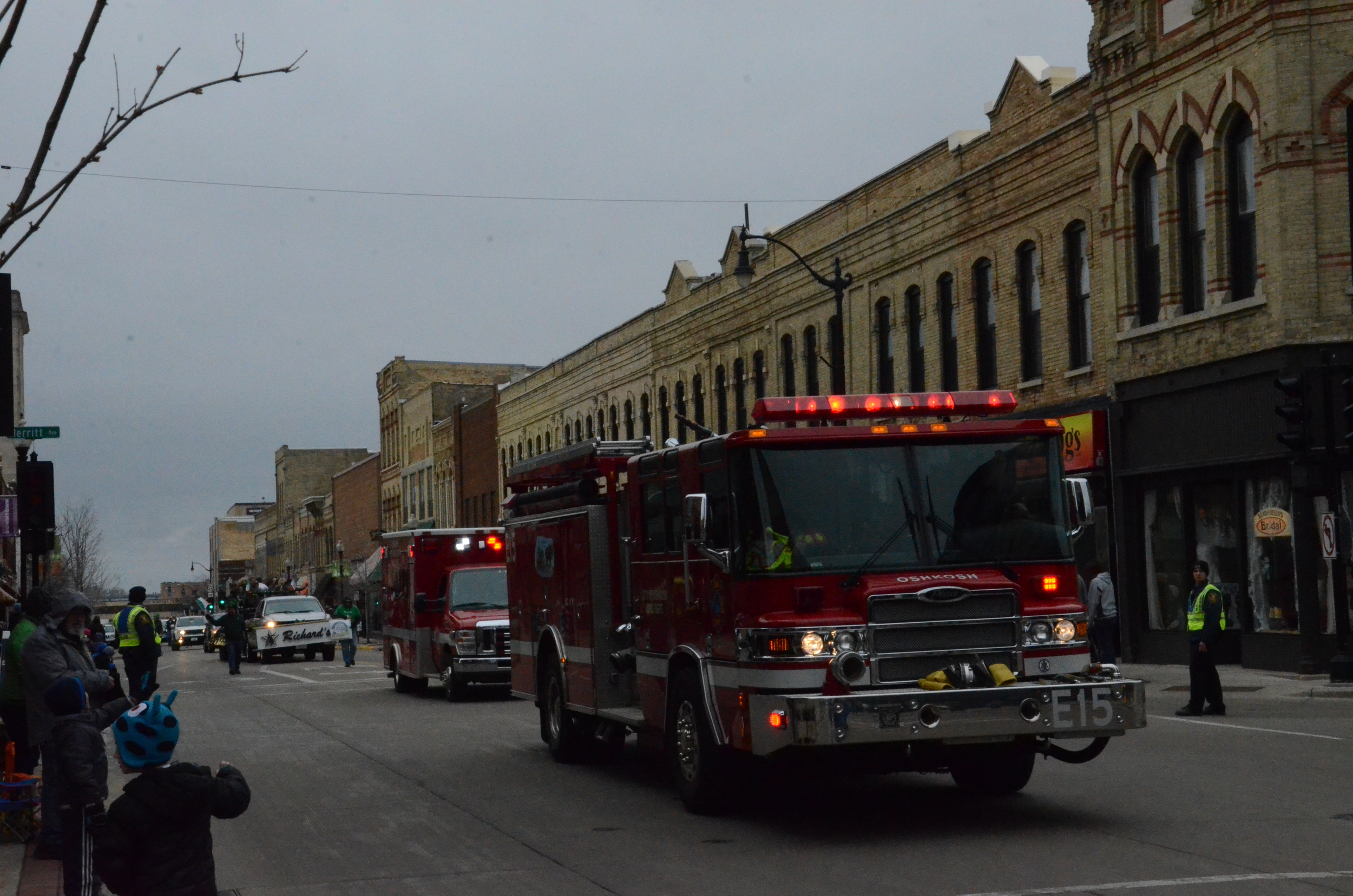he sirens can be heard for miles as the an Oshkosh firetruck and ambulance make their way through the parade.