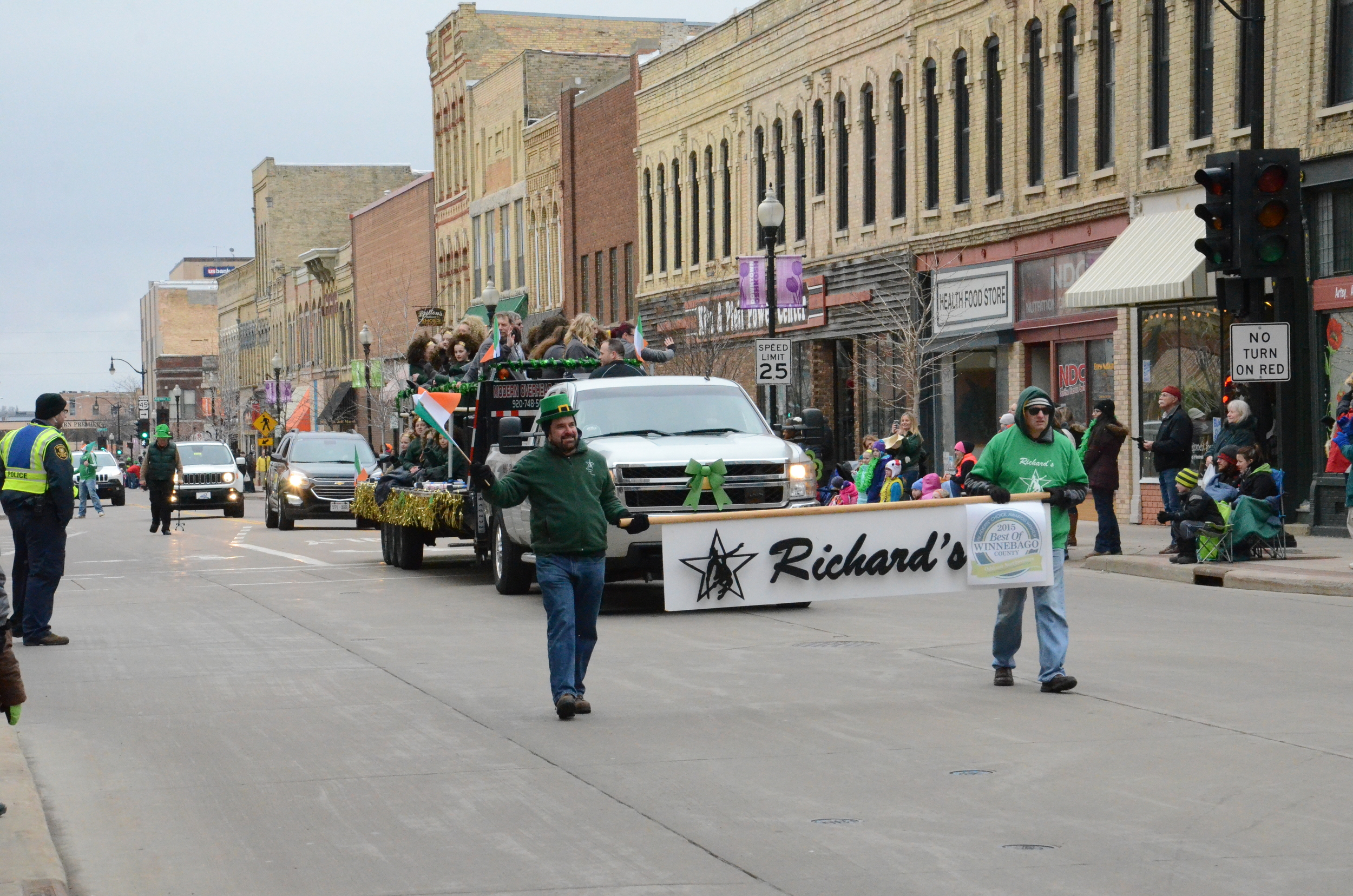 shkosh's very own Richard's School of Dance makes their way down Main Street and are introduced by their Richard's sign.