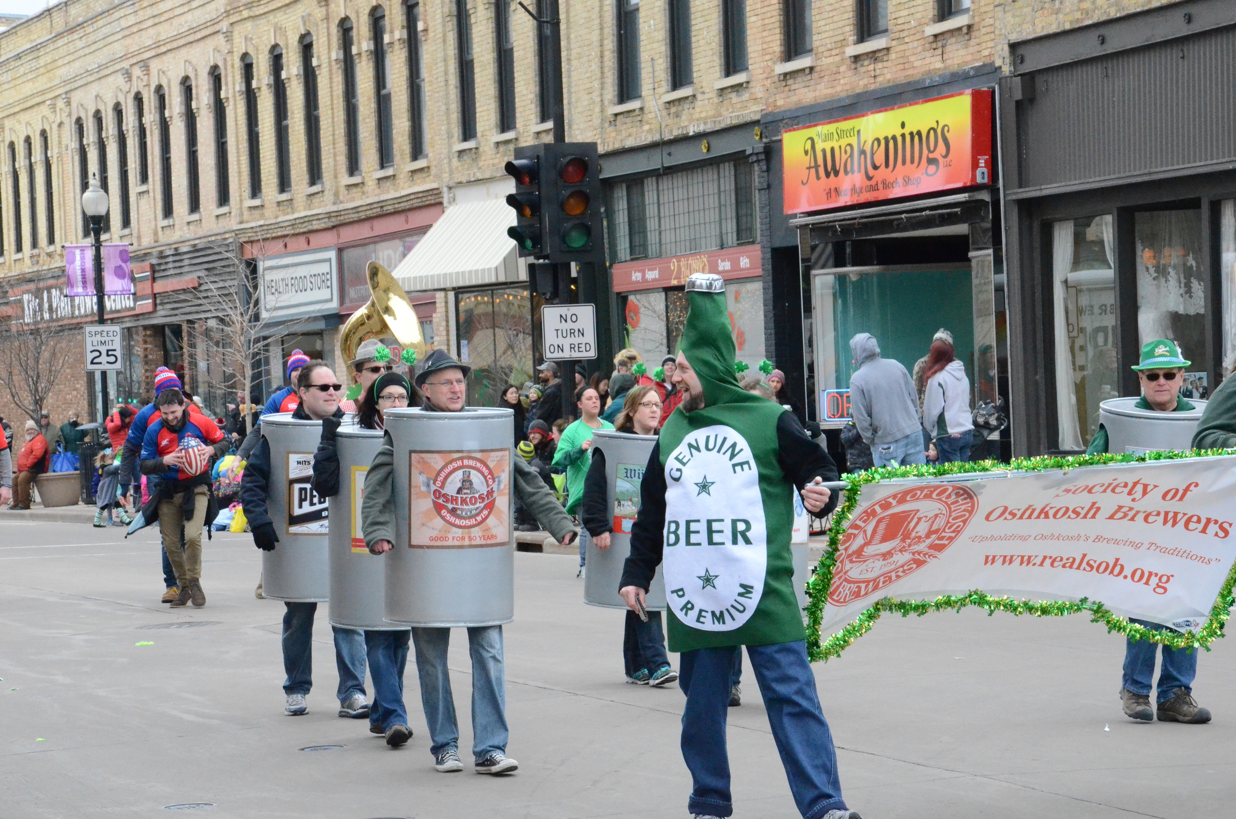 he parade concludes with the Society of Oshkosh Brewers. Each member wears a costume of their favorite brew.