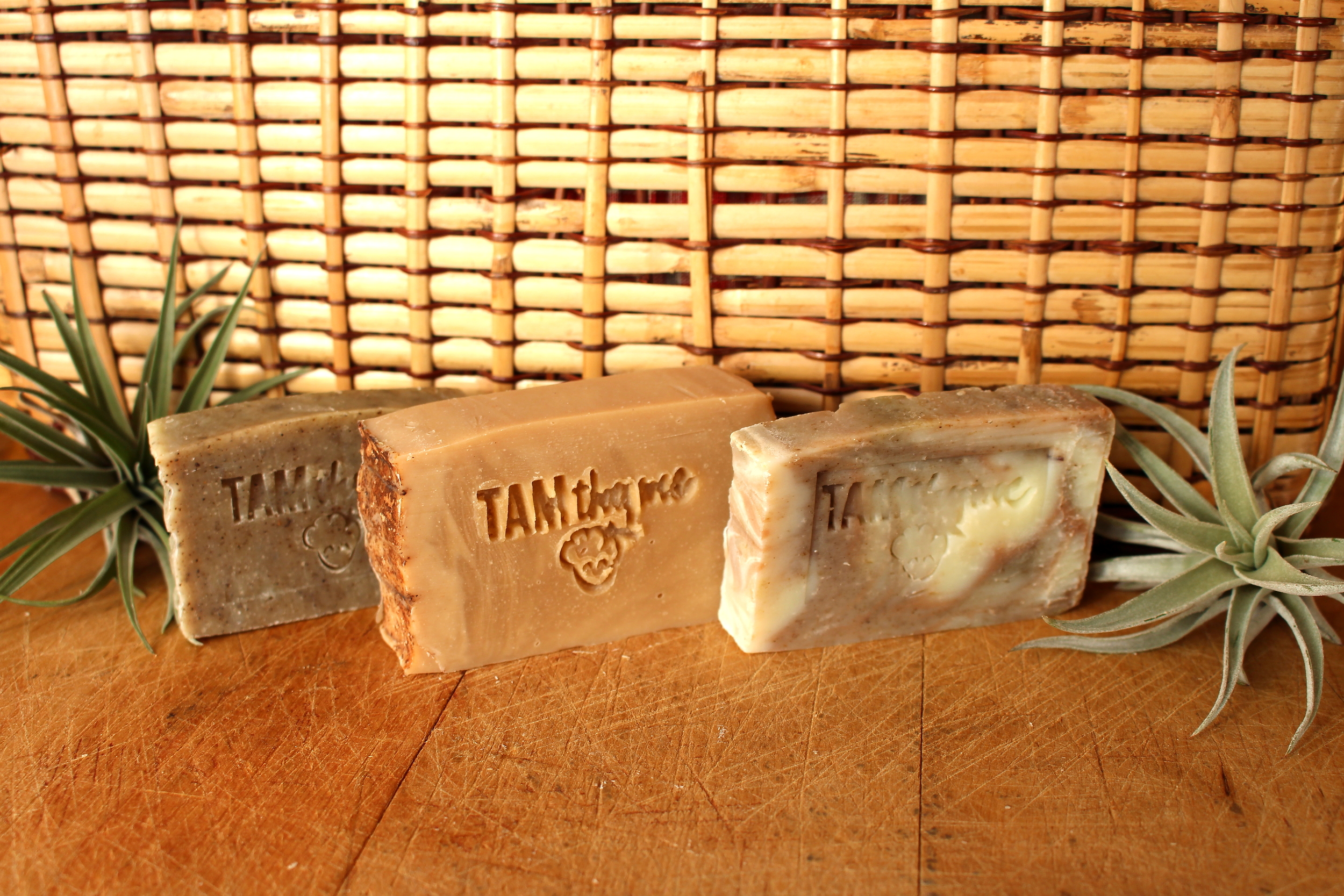 (FROM LEFT TO RIGHT) SAGE COLORED SOAP, MOROCCAN CLAY COLORED SOAP, MOROCCAN CLAY & NETTLE COLORED SOAP