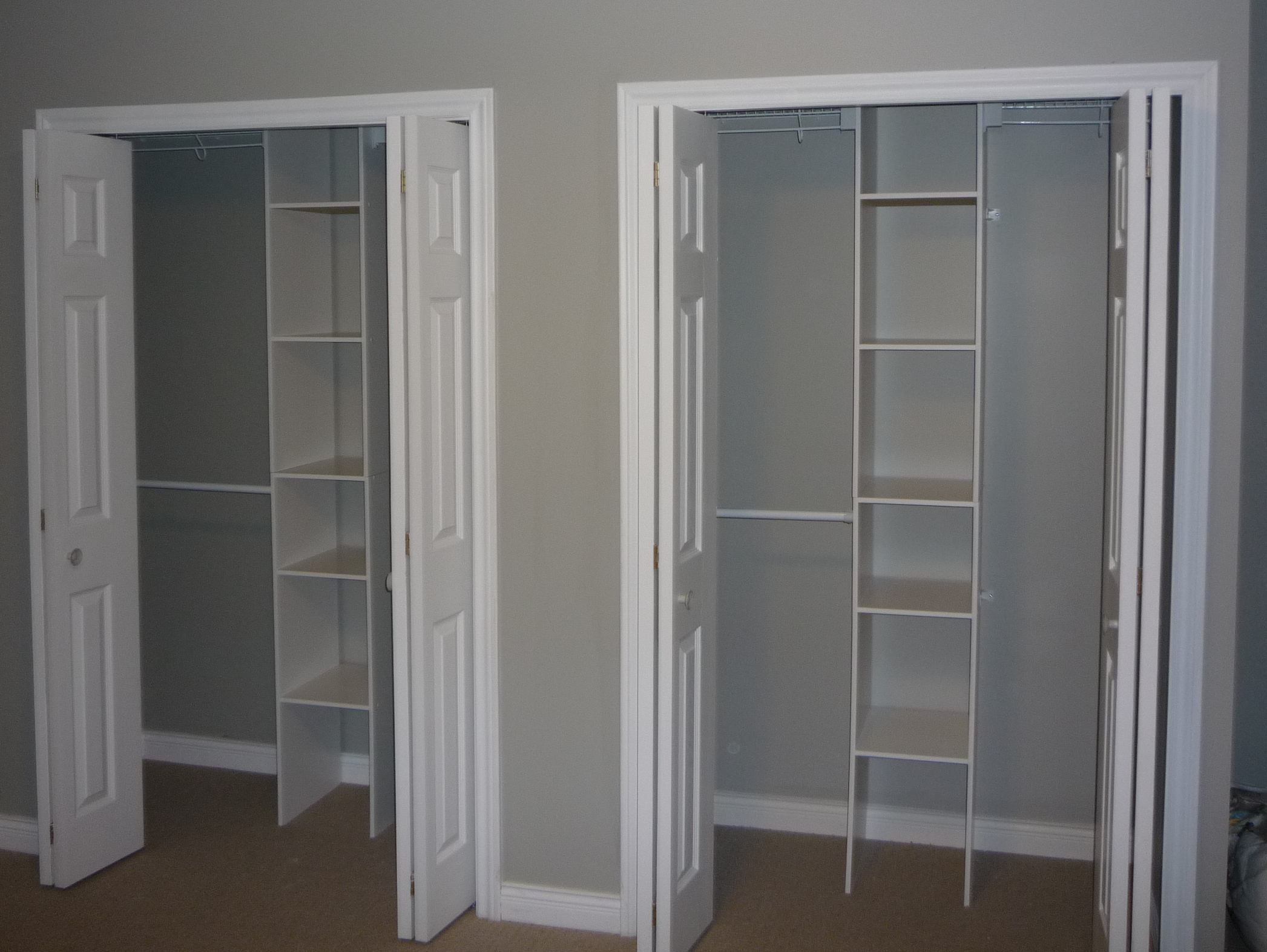 Reach-In Closets with Interior Organizers in Master Bedroom
