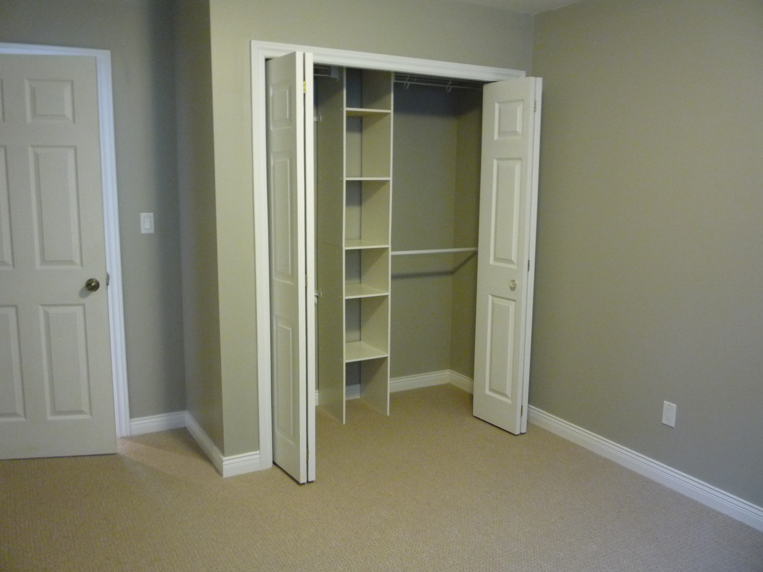 Reach-In Closet with Interior Organizers in Bedroom