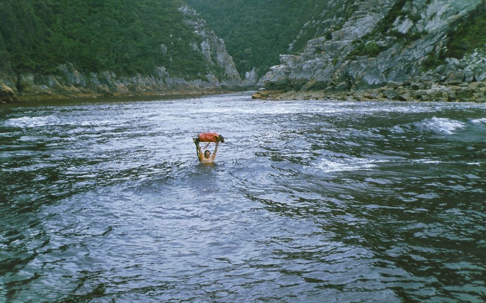 Henk, Eras' dad, smuggling a waterproofed backpack and a moustache through the Bloukrans River.