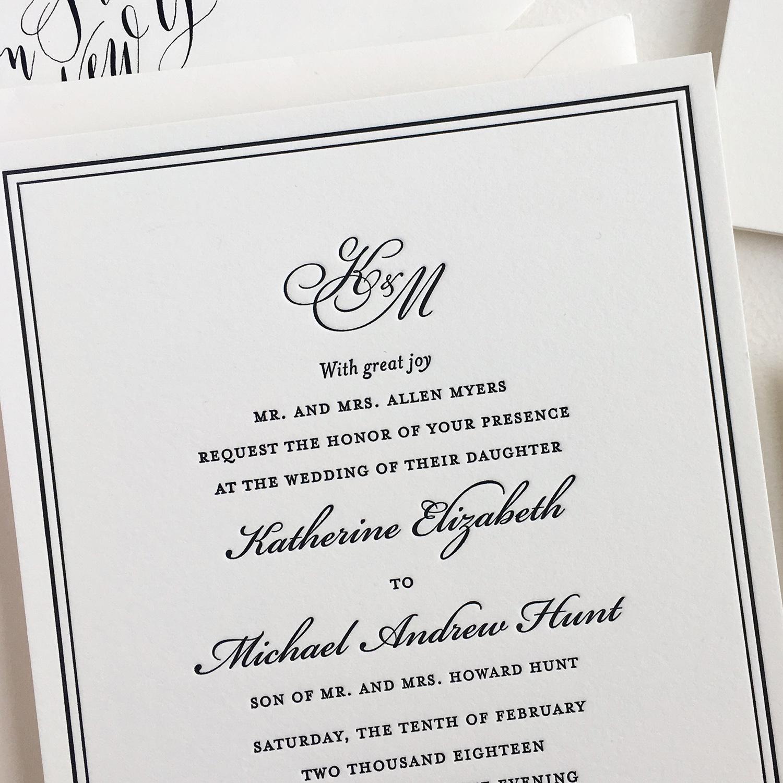 Custom printed wedding invitation with monogram