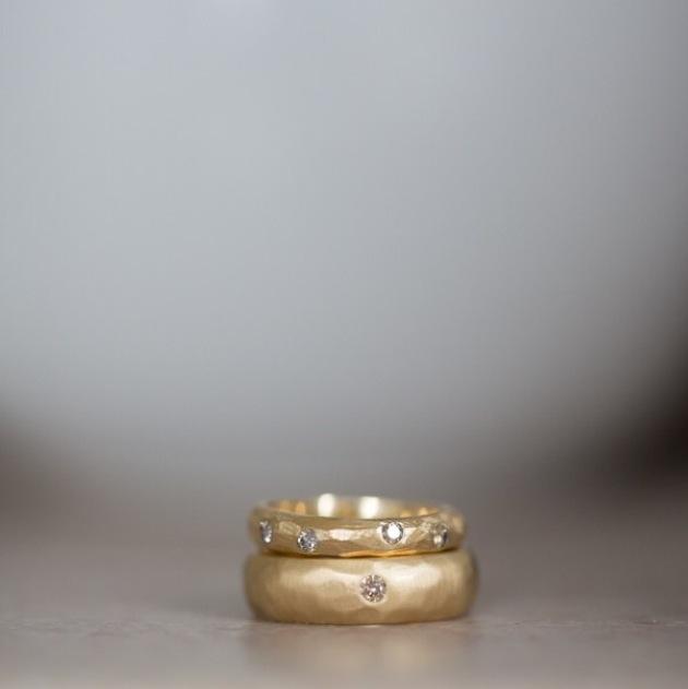 Mika + Ben (wedding bands)  18k yellow gold, chocolate diamonds.  Photo credit: Bonica Ayala