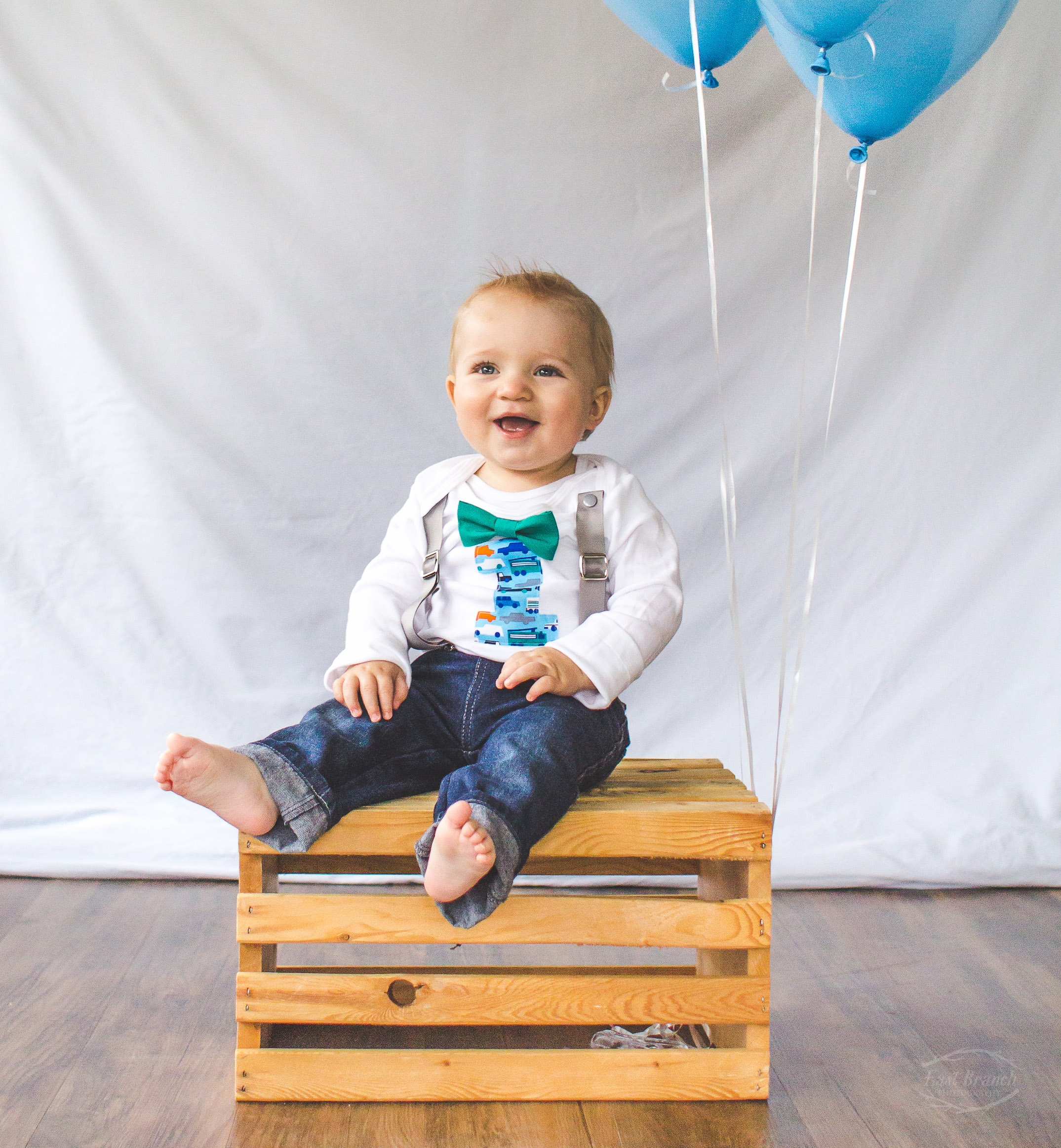 I'm a sucker for bowties and suspenders and smiling baby boys.