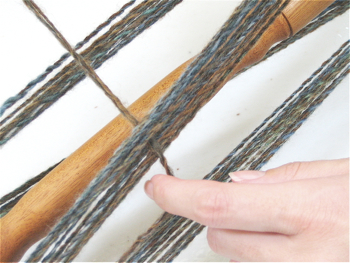 Once you have finished skeining the yarn, secure both ends.