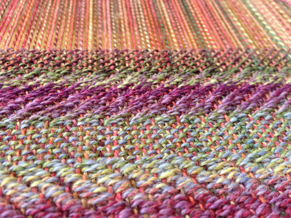 Current weaving project that combines a straight twill with plain weave.  Warp and weft are both my handspun yarn.