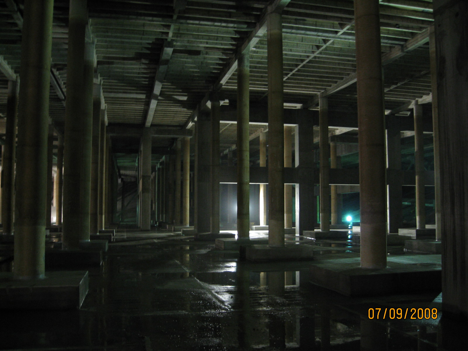 The interior of the rehabilitated Sunset Reservoir.  This project included stabilization of the soil dam embankment; a retrofit of the walls and roof using seismic joints, shear walls, diagonal bracing, and struts; foundation improvements; repairing deteriorated concrete; replacing part of the reservoir lining material; replacing inlet piping; installing security fencing; upgrading the landscaping; and other miscellaneous site improvements.
