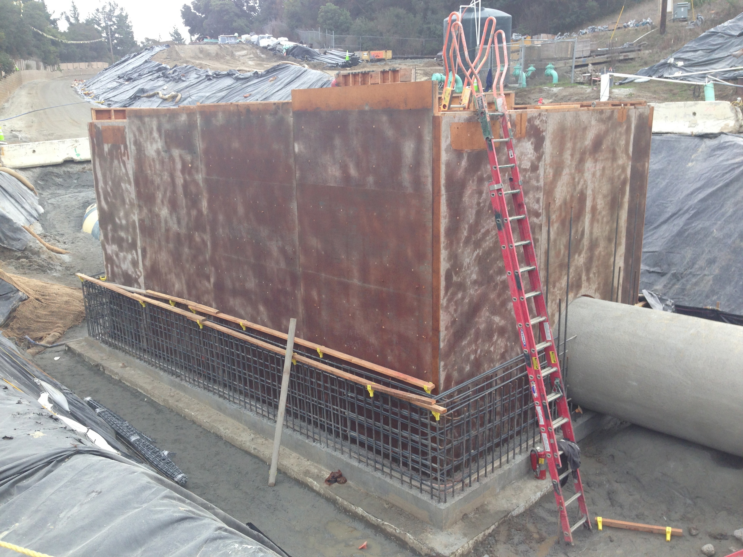 This wall rebar and formwork is in place for a new vault for the Venturi meter.The meter uses a converging section of pipe converging section of pipe to give an increase in the flow velocity and a corresponding pressure drop from which the flow rate can be calculated.