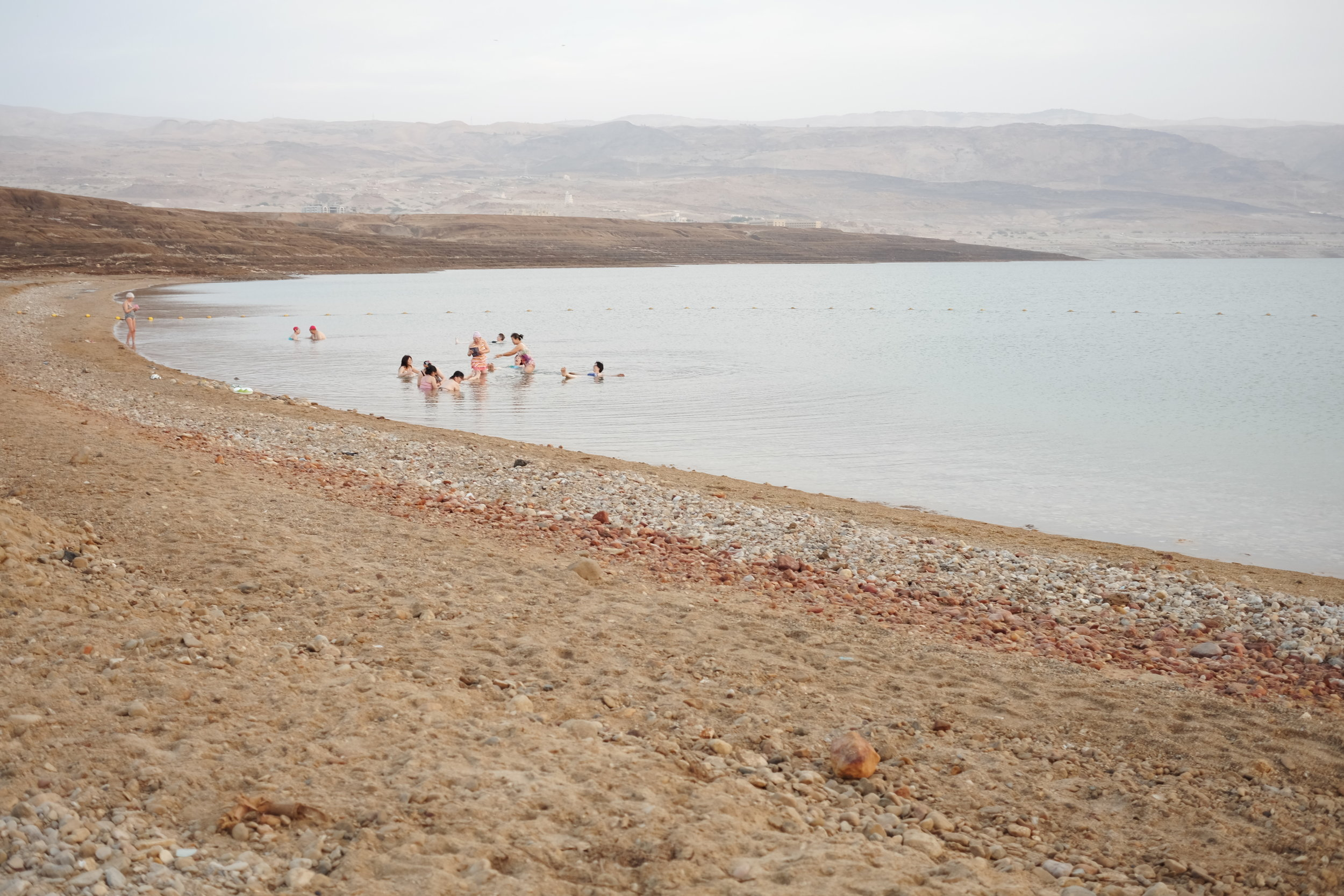 Chinese tourists floating in the Dead Sea