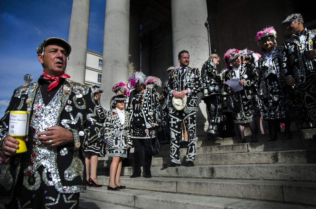 The Pearlies stand on the steps of St. Martin in the Fields in a display of black and buttons attracting the attention of passers by to donate to the church in honour of the Harvest Festival.