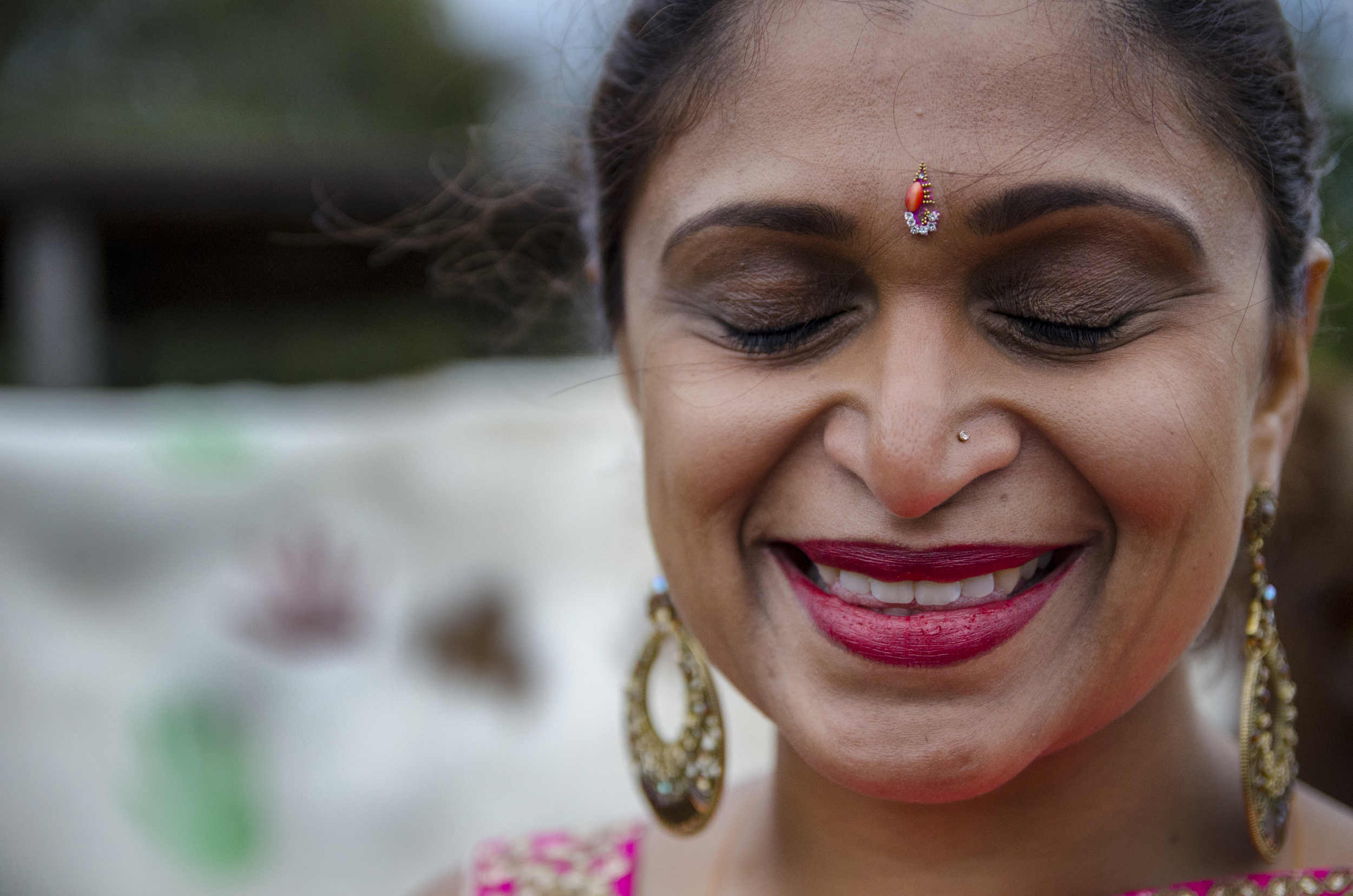 Mrs. Ruda grins in response to warm words from her husband, Mr. Ruda onthe Diwali festival at Bhaktivedanta Manor Hare Krishna Temple in Watford, London, UK.