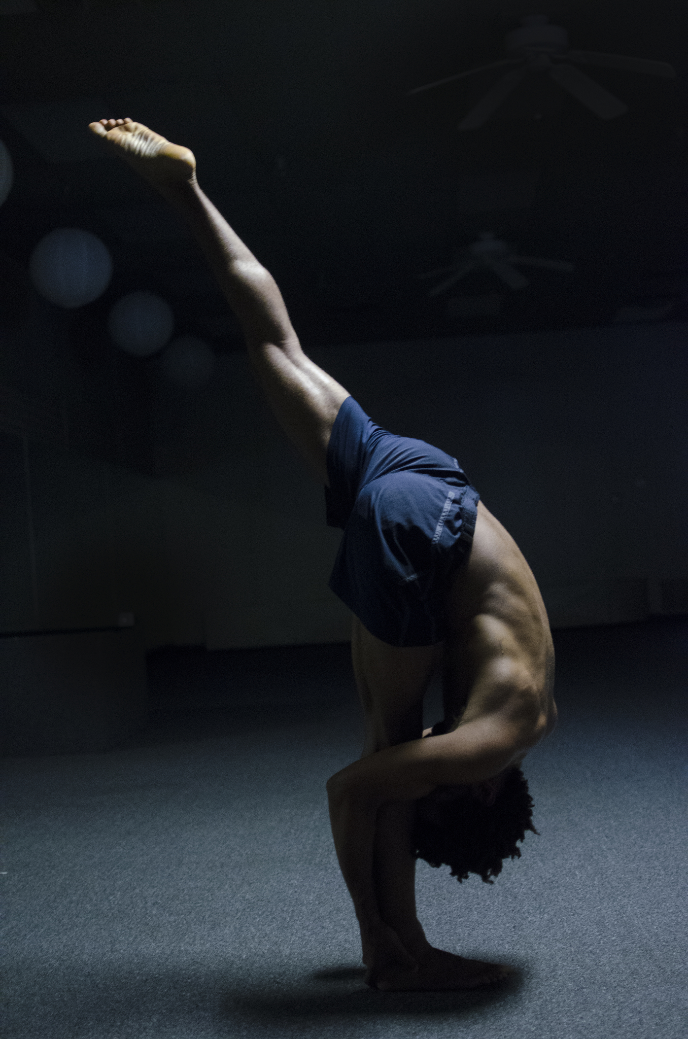 After teaching two hot yogaclasses in one day, Joel Lindo performs advanced level poses in the studio.