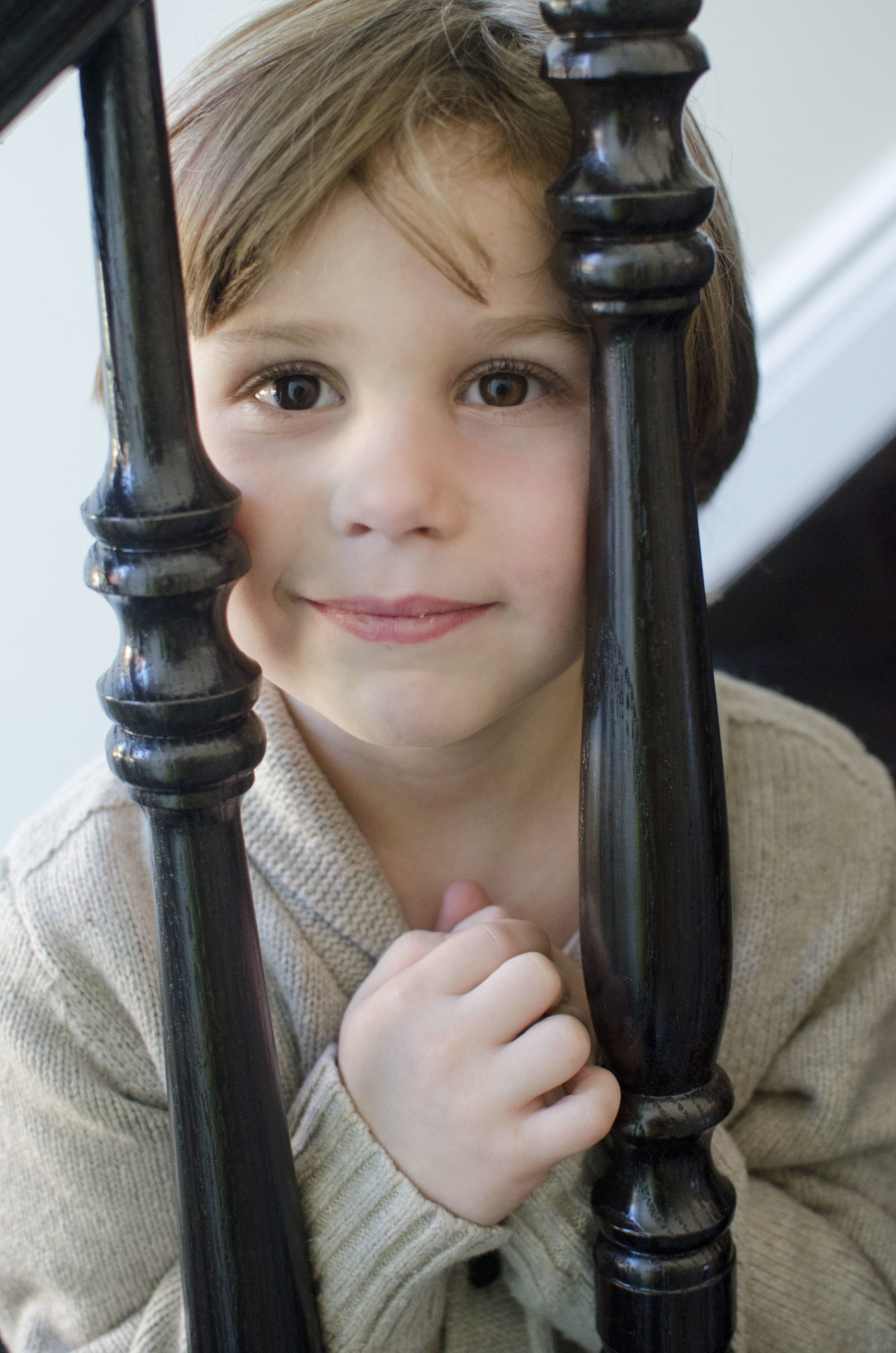 Victor Pahuskin, age 4, smiles, but only because his Mommy asked him to.