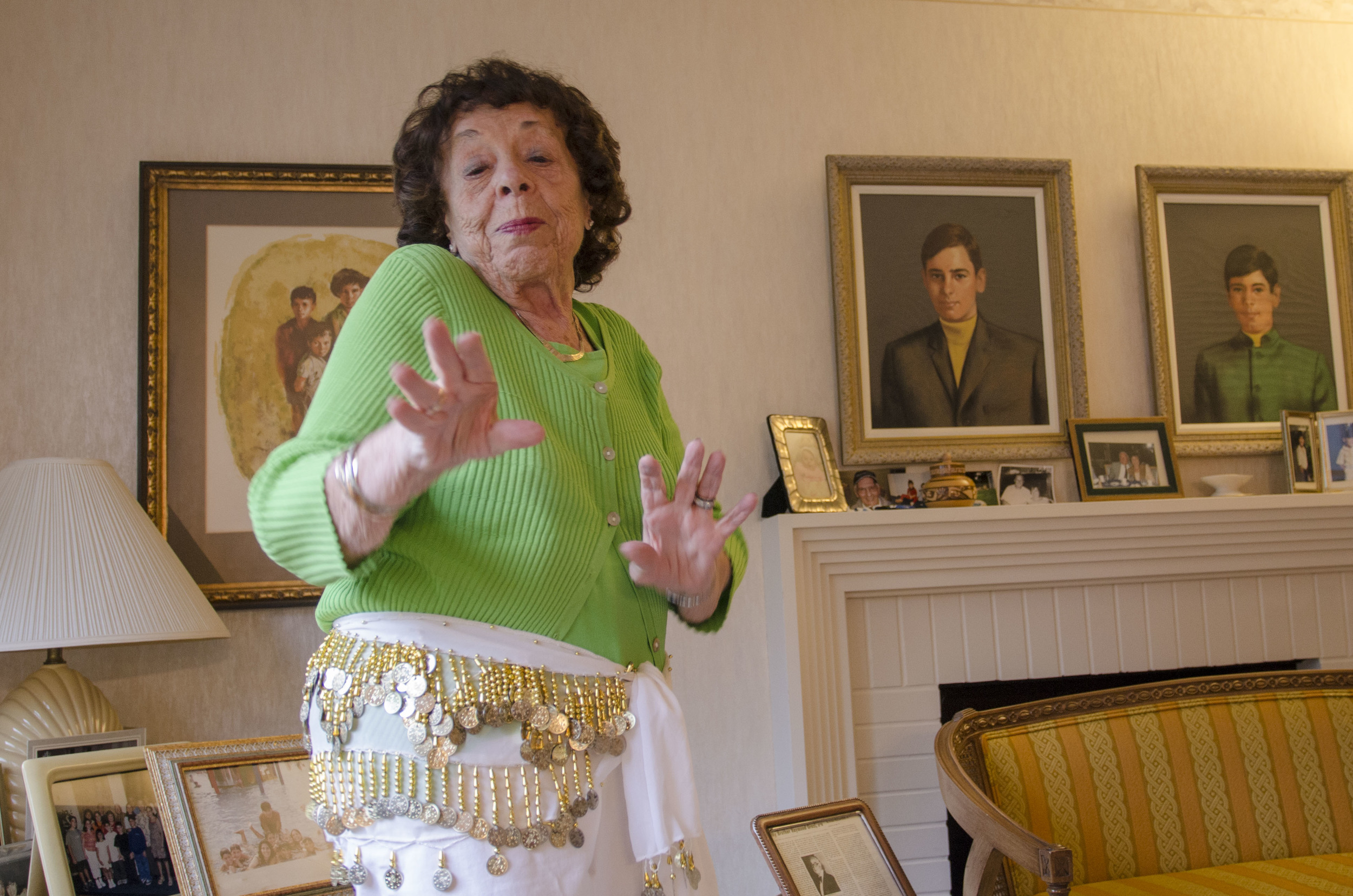 Showing off her new jingling coin skirt, Emma Pahuskin shimmies around her living room in West Hartford, CT.