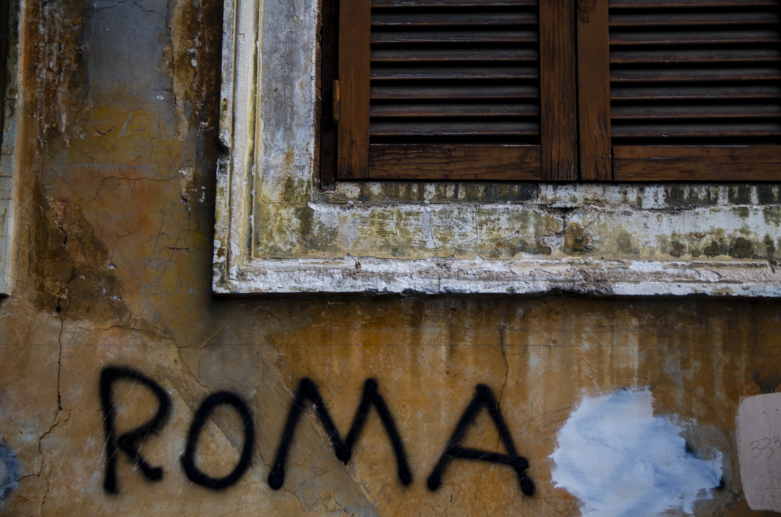 The Eternal City shows its age and youth simultaneously as the paintcrumbles andplaster is slathered with modern graffiti.