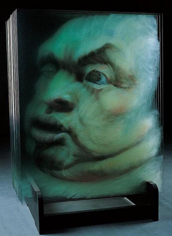 3-d paintings on layers of glass by artist  xia xiaowan .