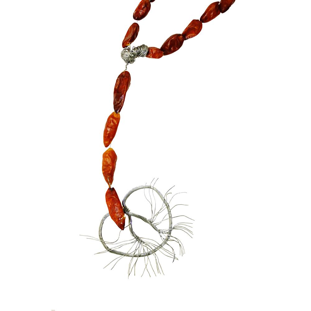 La Villita Devotional (detail), chile piquin, wire, list poem, 2010