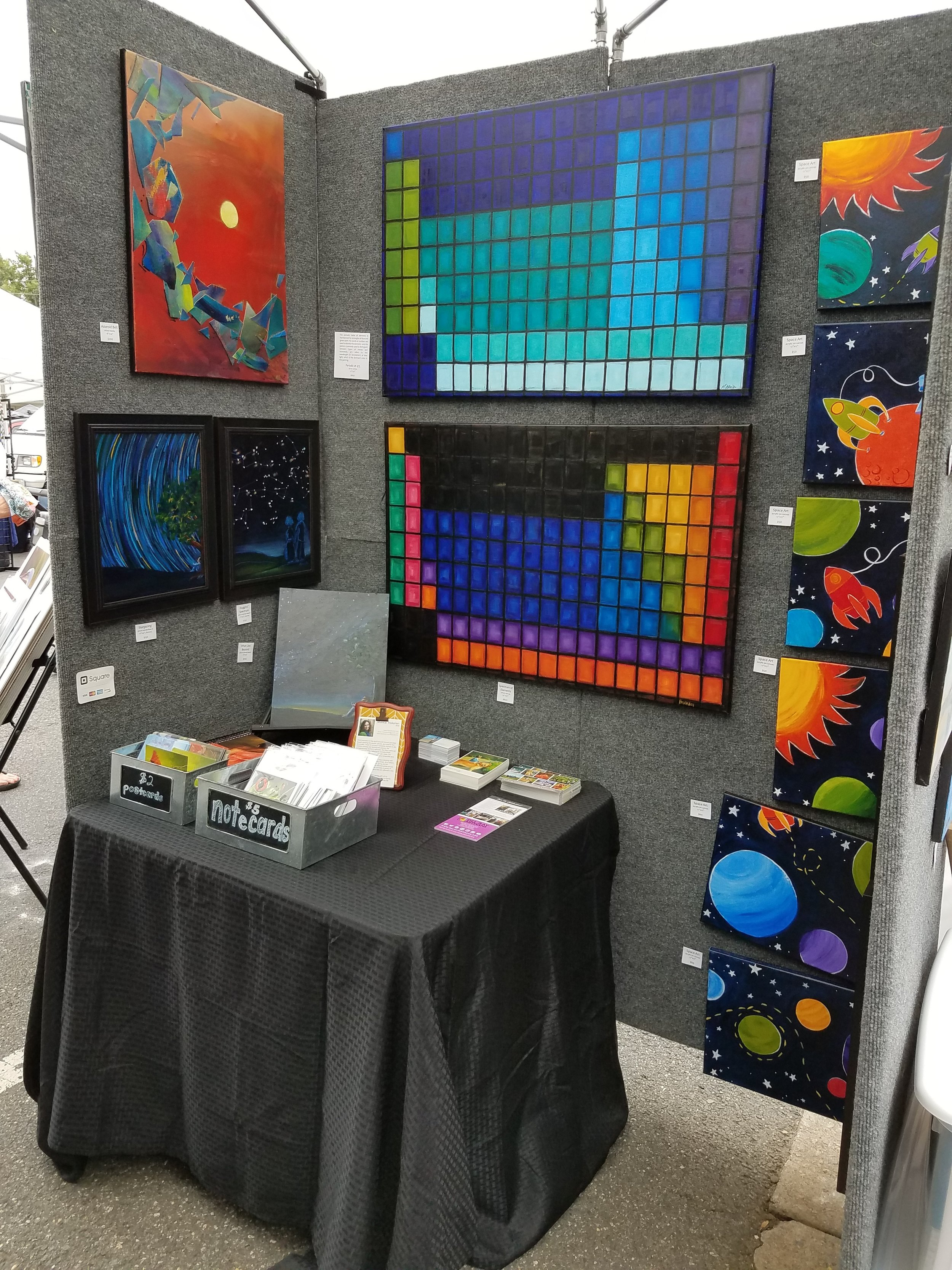 """Inside my tent - a """"Space and Science"""" room with a table for business cards, note cards, etc."""