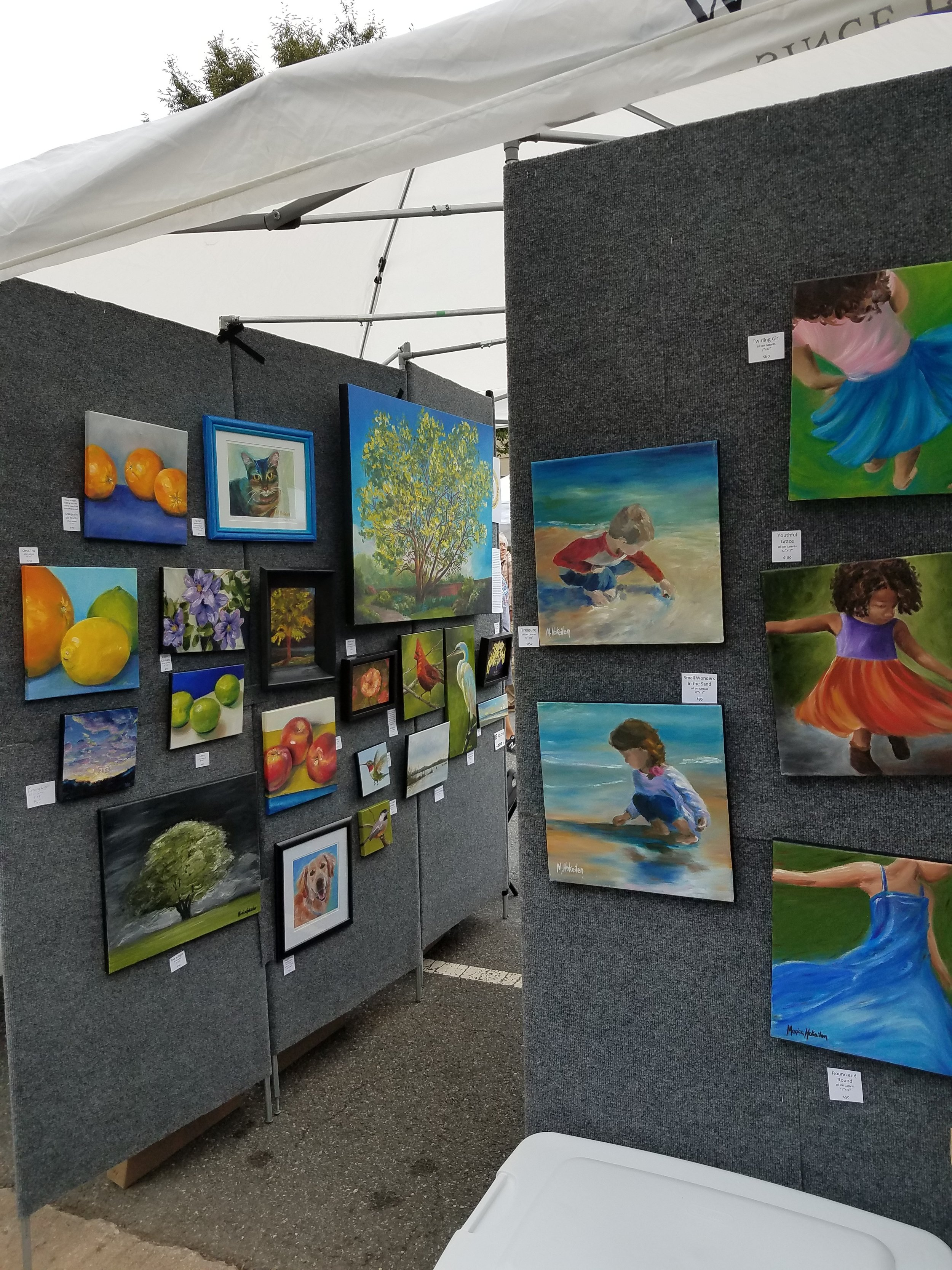 """Looking from the back grassy-side of my tent with """"Children at Play"""" and the other end of the wall with """"Local Sights"""" and """"In the Garden"""" and other favorites."""