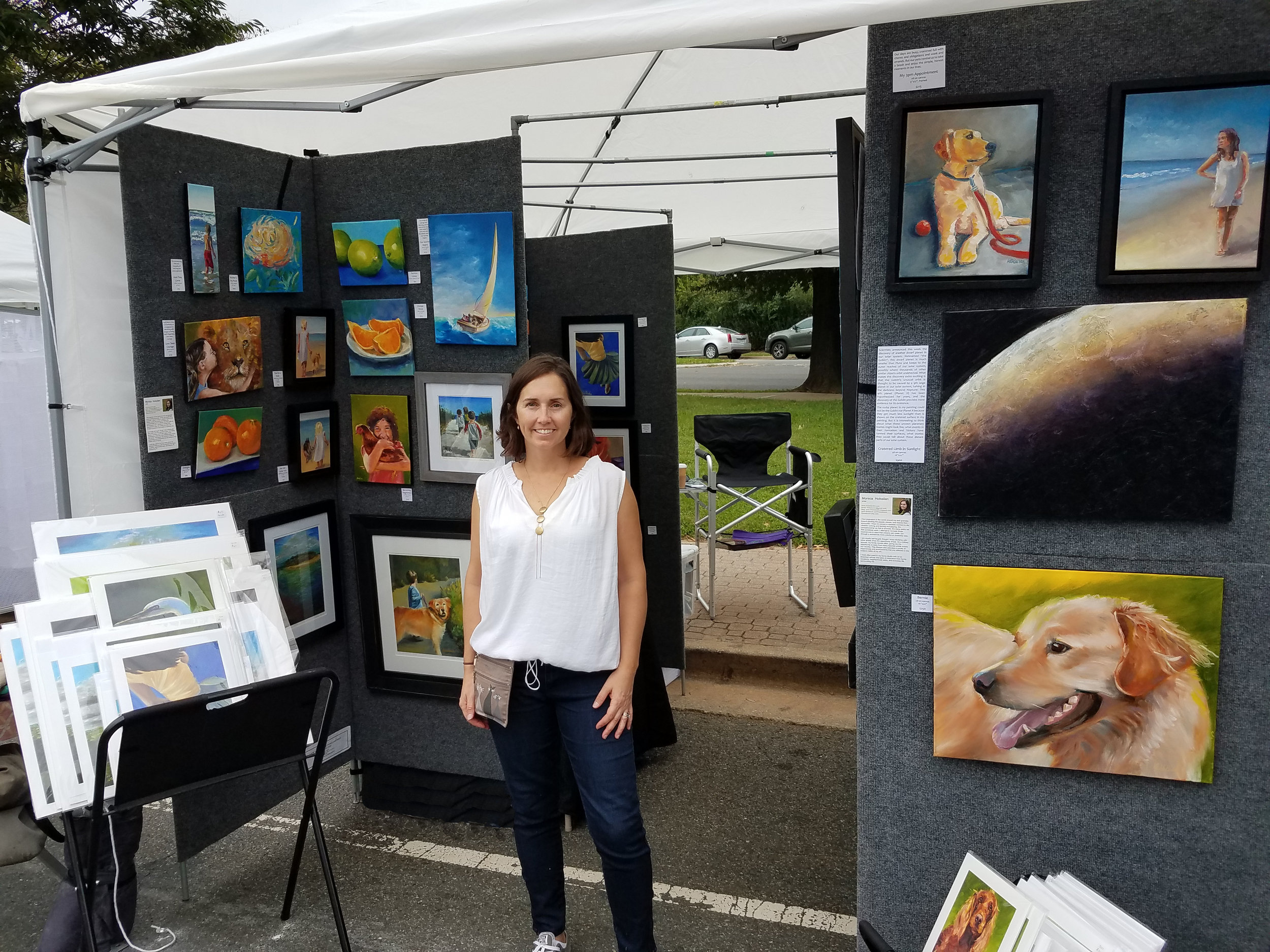 Monica Hokeilen standing in front of her tent at the Art on the Avenue festival, 6 Oct 2018.