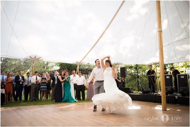Wood dance floor under a sailcloth tent.