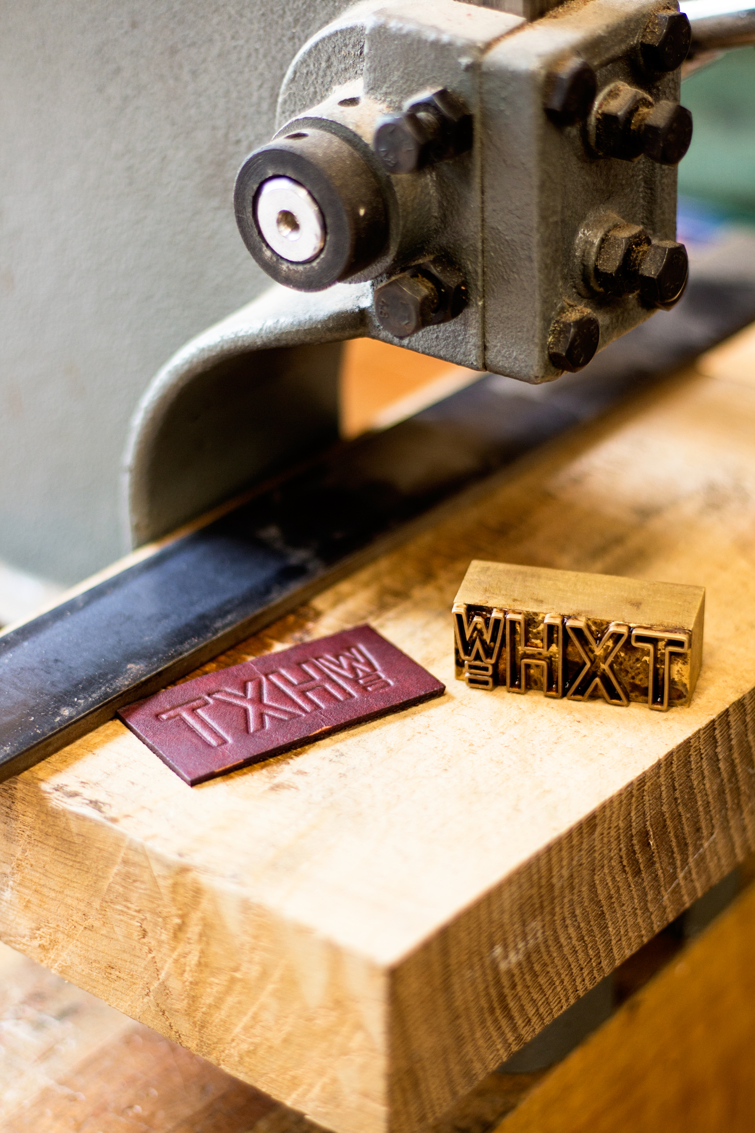 Hot off the press! A freshly stamped leather label, made using a brass stamp and an arbor press.