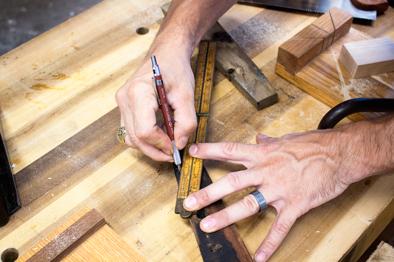 """Marking the cut line using my Stanley Rule & Level Co. Folding rule as a straightedge. I try to go about 1/8"""" past the burned spots on the wood. I don't want any charred wood along my glueline. It wouldn't have the structural integrity needed."""
