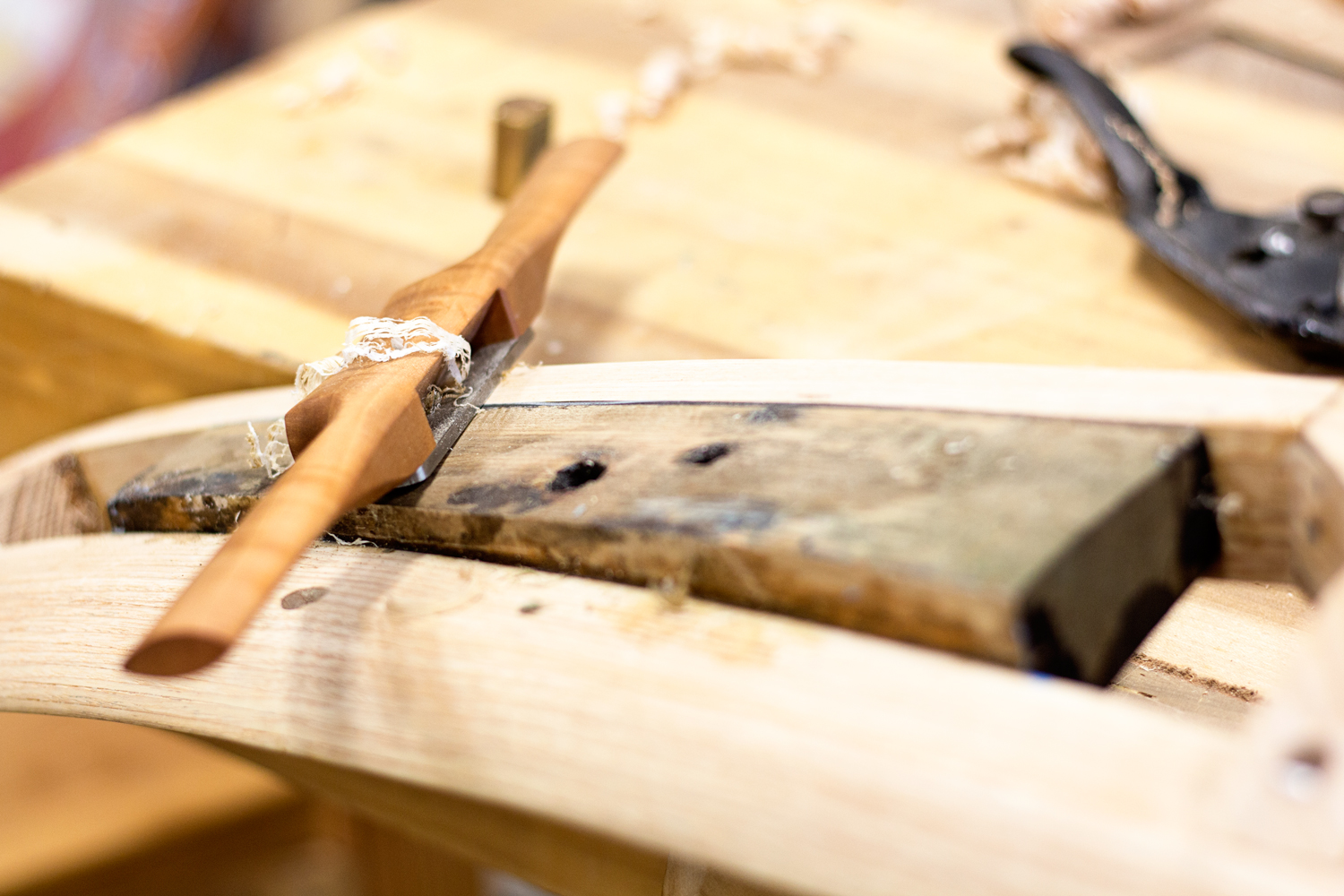 I'm smoothing transitions between wooden pieces using my Caleb James wooden spokeshave. I used this tool all over this project, putting the finishing touches on so many different areas.