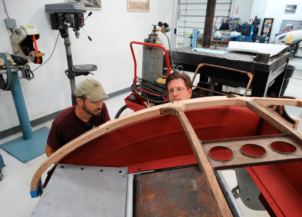 """This was the moment I had been nervously anticipating over the last 6-7 months. During the entire rebuild process, I never had the opportunity to test fit my work on the car. The car was three hours from my shop, so all of the build had to be performed based off of my notes and photos that had been taken. When we set the wooden frame onto the car frame for the first time, it seated with a satisfying """"thunk"""", nestling down on the mounting lugs as if it had been there its whole life."""