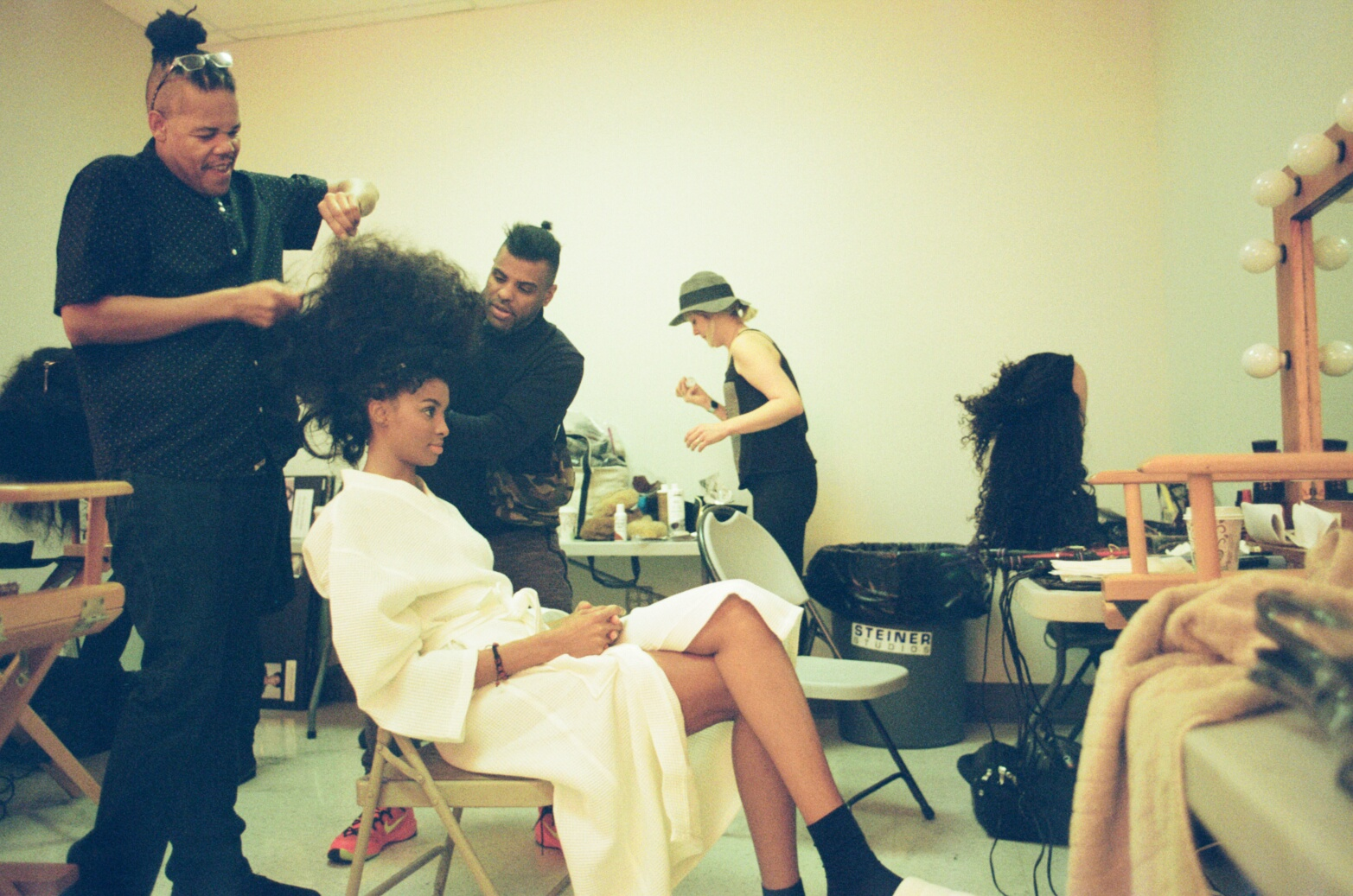 Tierra Benton gets prepared for set with celebrity stylist Chucki Love and his team of talented experts.